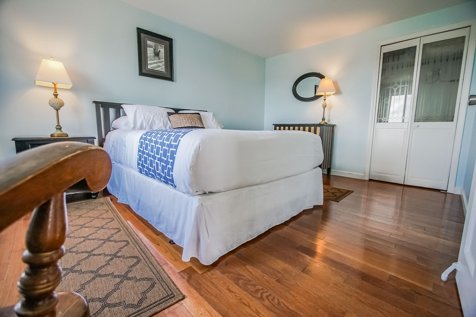 An airy master bedroom  at VRI's Neptune House Resort in Rhode Island.
