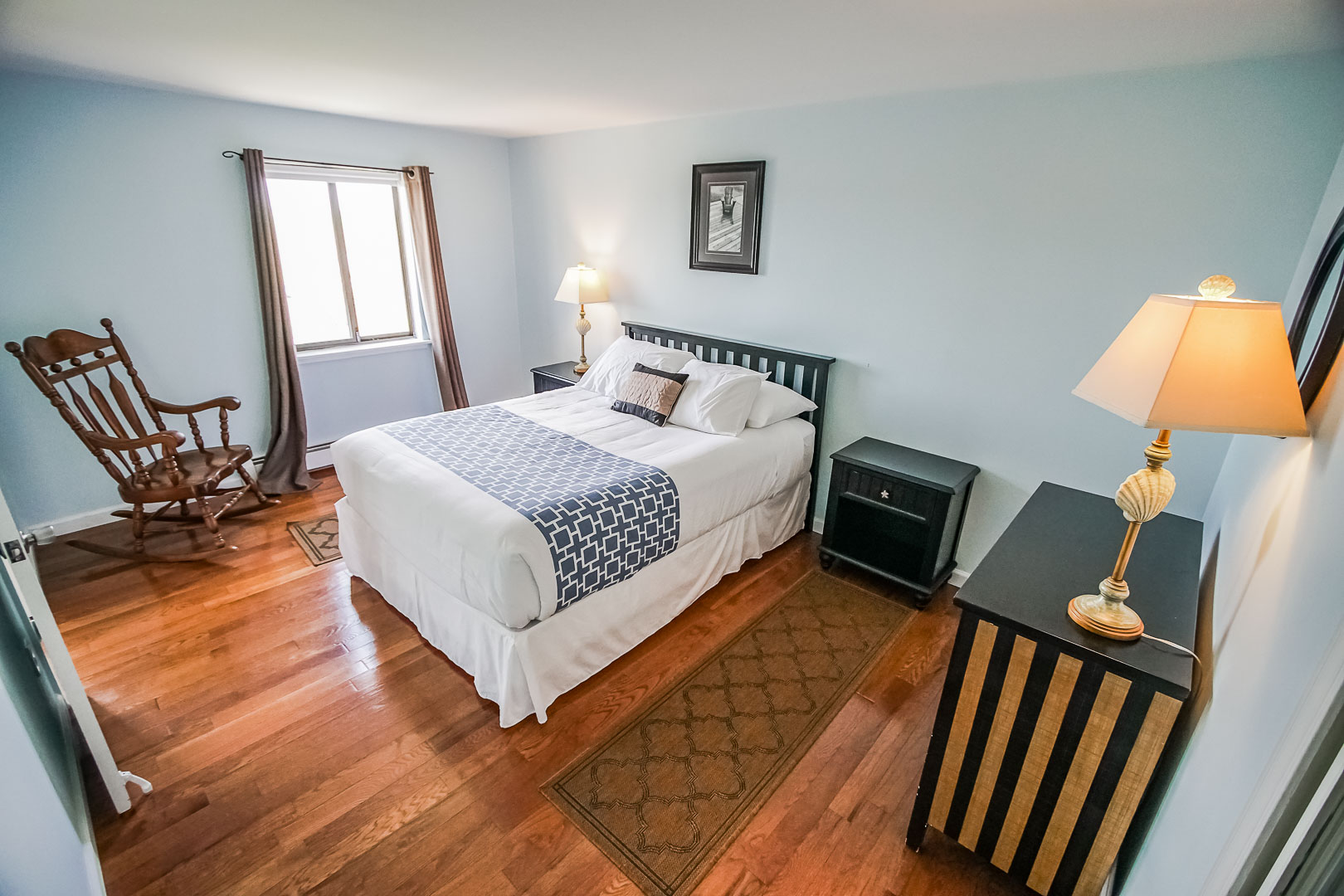 A spacious master bedroom  at VRI's Neptune House Resort in Rhode Island.