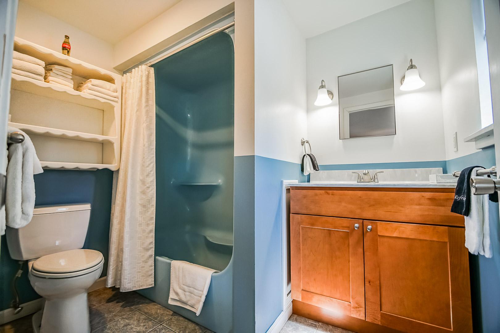 A cozy bathroom  at VRI's Neptune House Resort in Rhode Island.