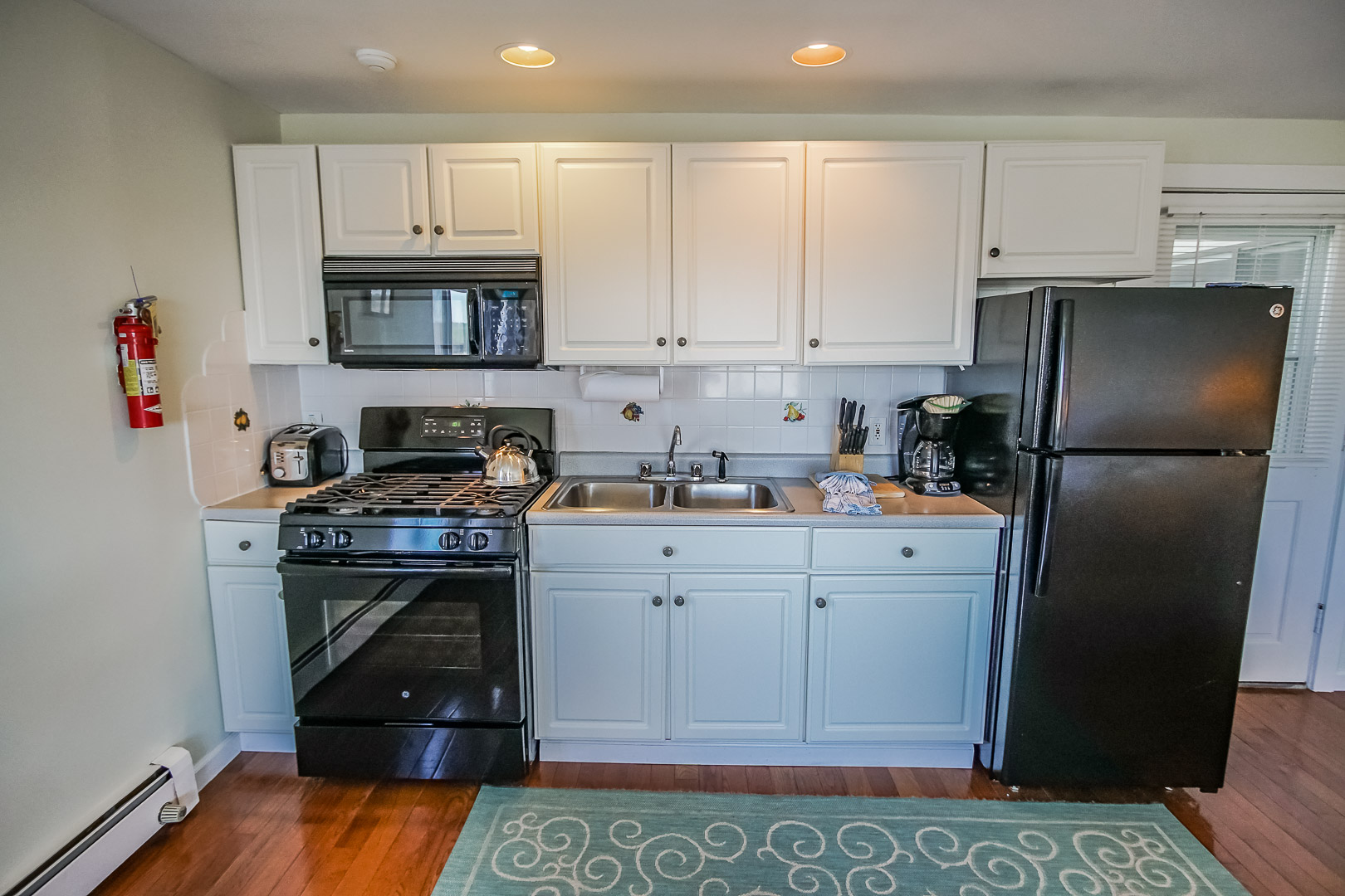 A traditional Kitchenette at VRI's Neptune House Resort in Rhode Island.