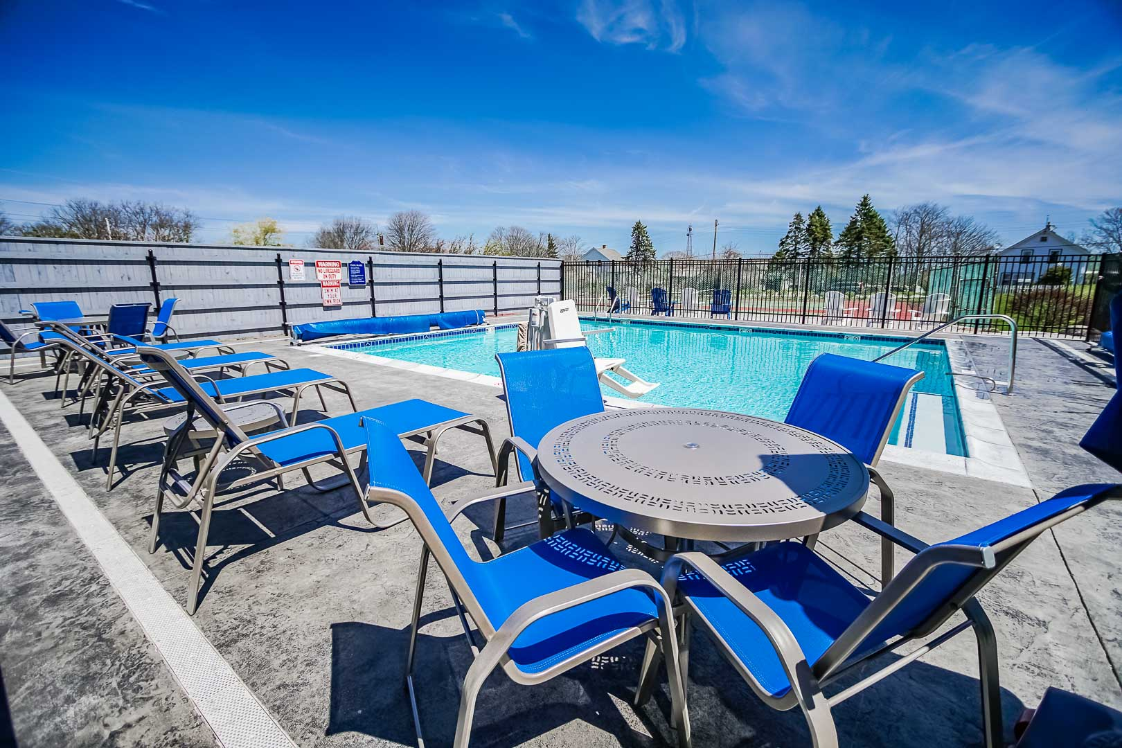 A spacious outdoor swimming pool at VRI's Neptune House Resort in Rhode Island.