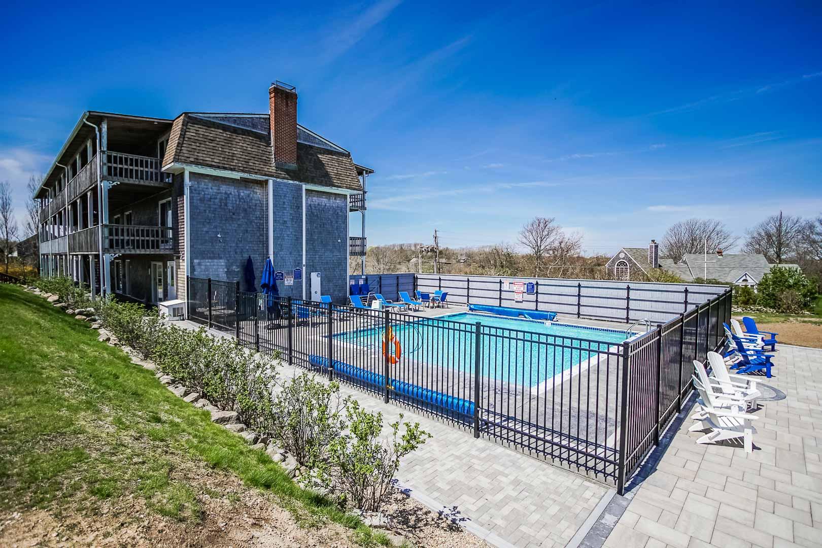 A scenic swimming pool at VRI's Neptune House Resort in Rhode Island.