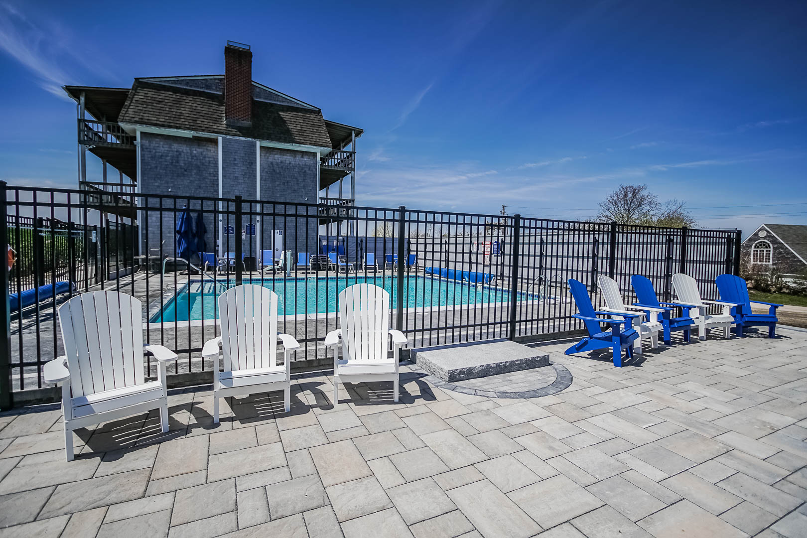 A spacious swimming pool area at VRI's Neptune House Resort in Rhode Island.