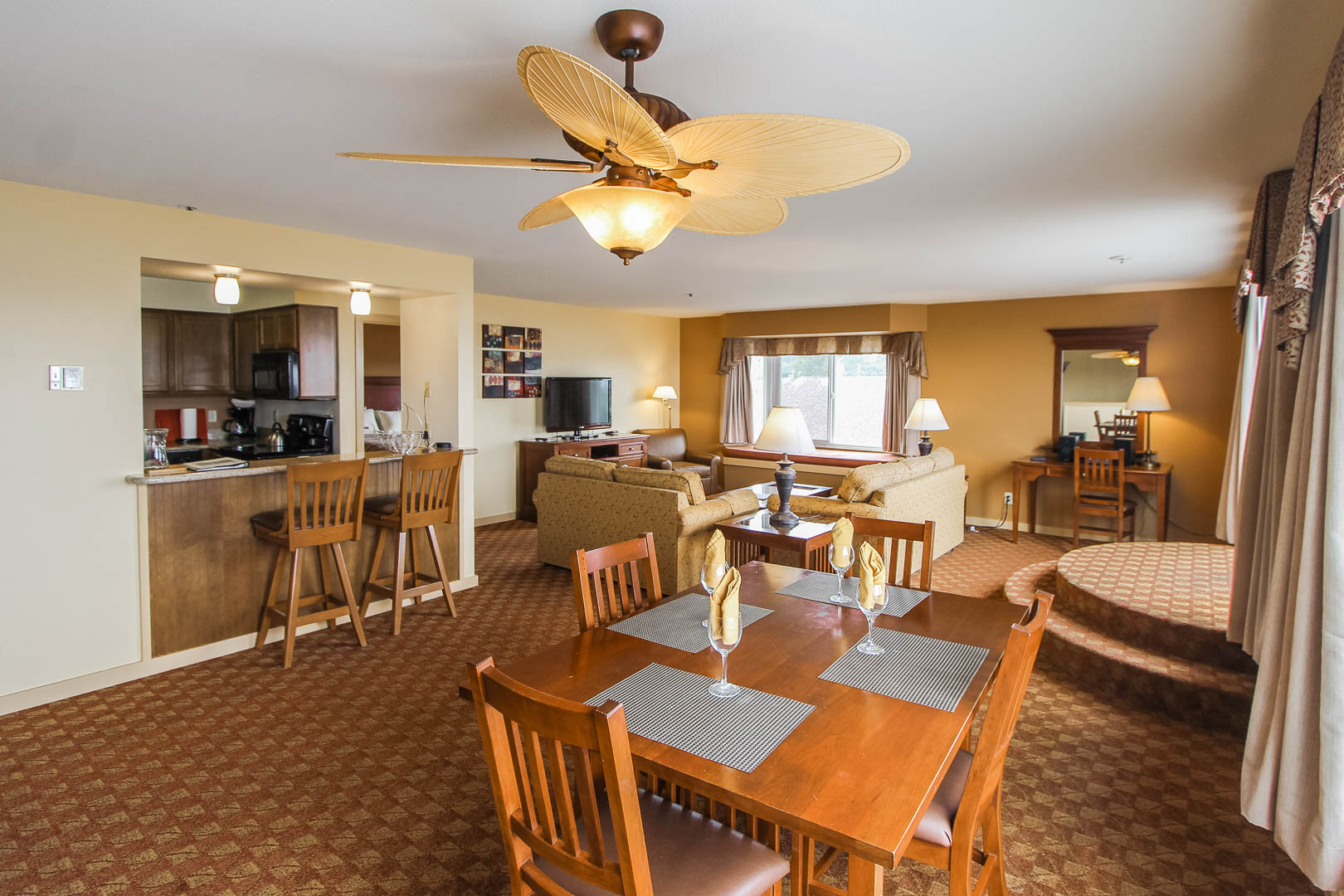 A spacious living and dining room area at VRI's Pacific Grove Plaza in California.