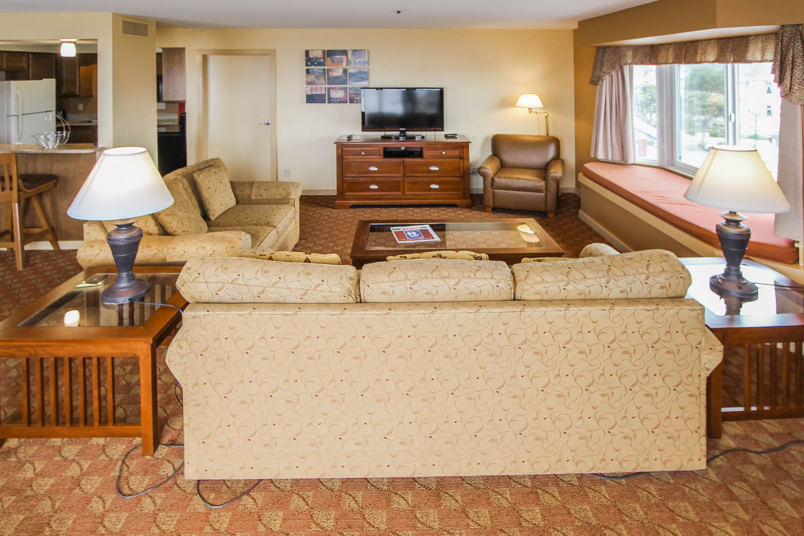 A spacious living room area at VRI's Pacific Grove Plaza in California.