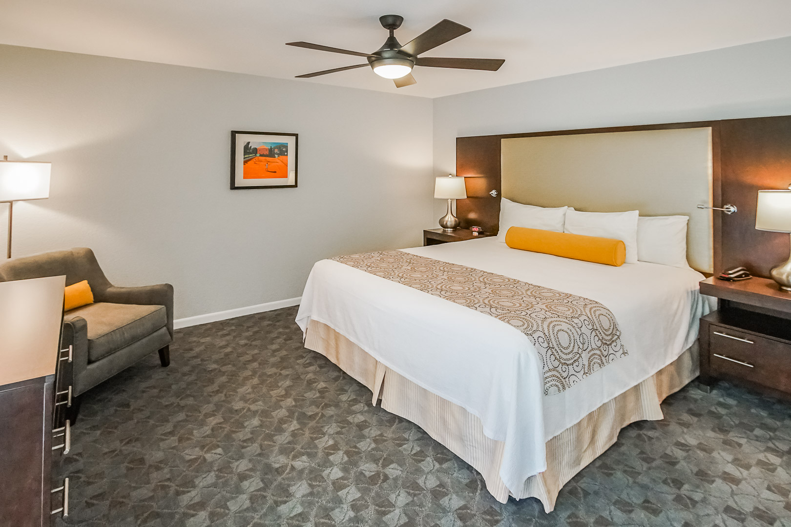 An expansive master bedroom with a king size bed at VRI's Palm Springs Tennis Club in California.