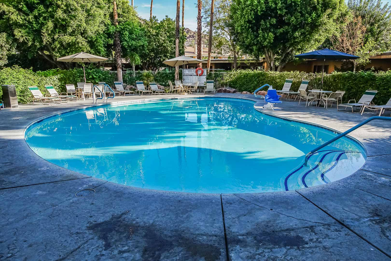 A peaceful outdoor swimming pool at VRI's Palm Springs Tennis Club in California.