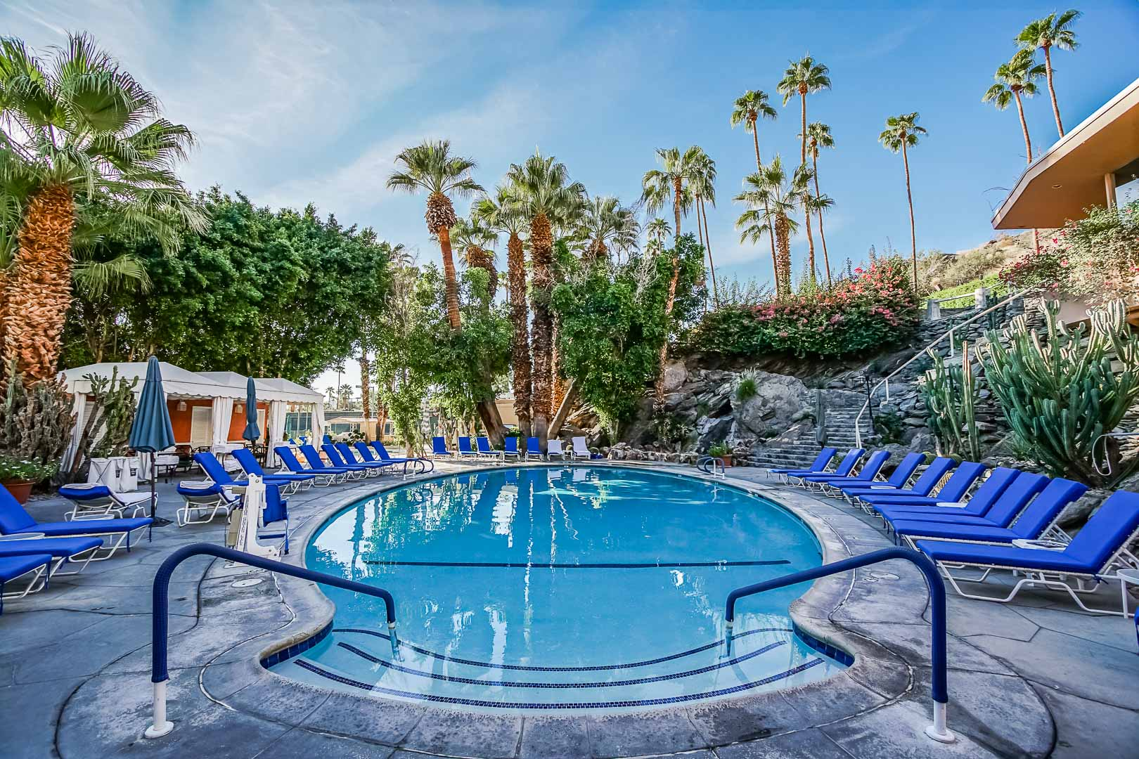 A peaceful view of the outdoor swimming pool at VRI's Palm Springs Tennis Club in California.