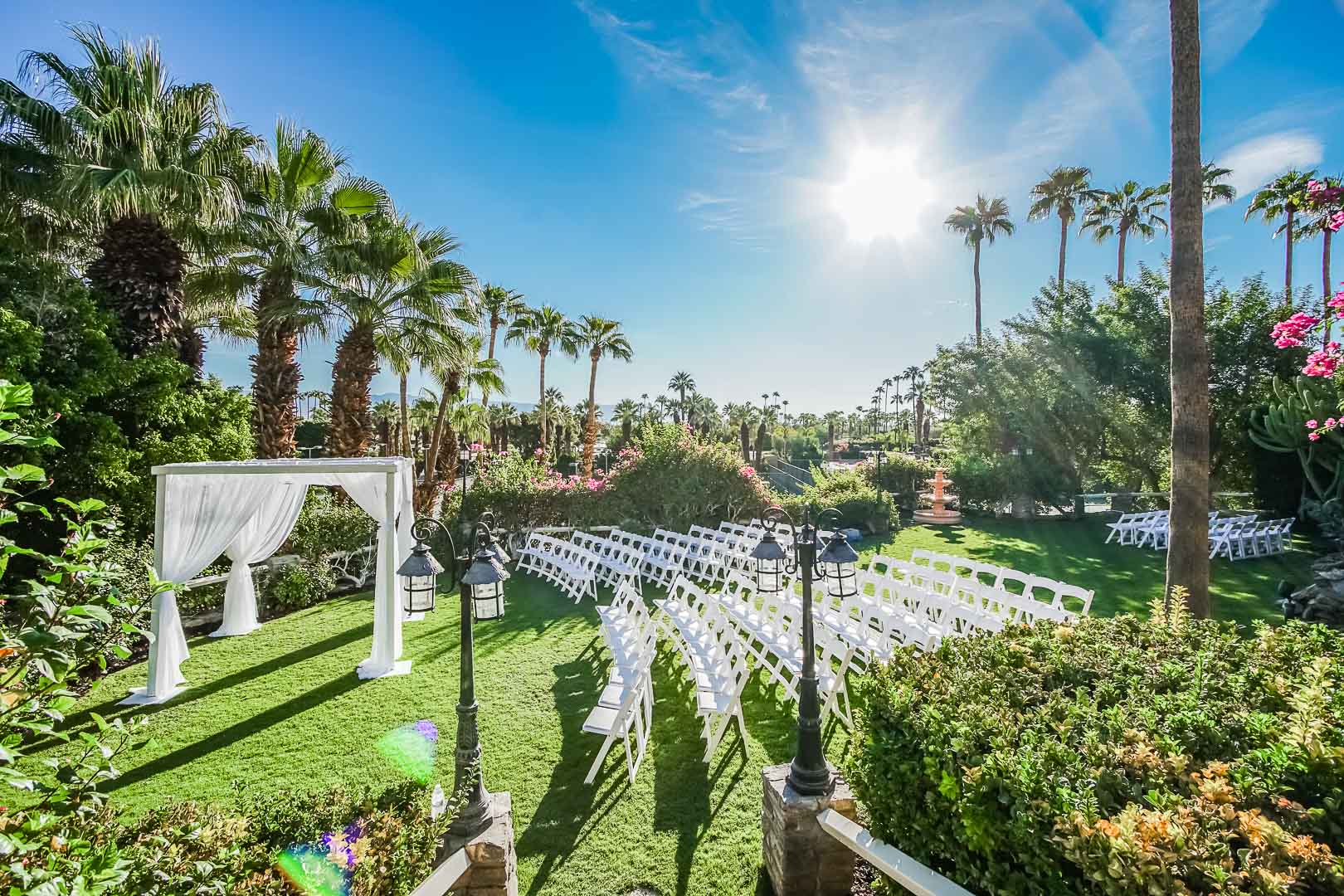 A breathtaking view of an outdoor wedding ceremony at VRI's Palm Springs Tennis Club in California.