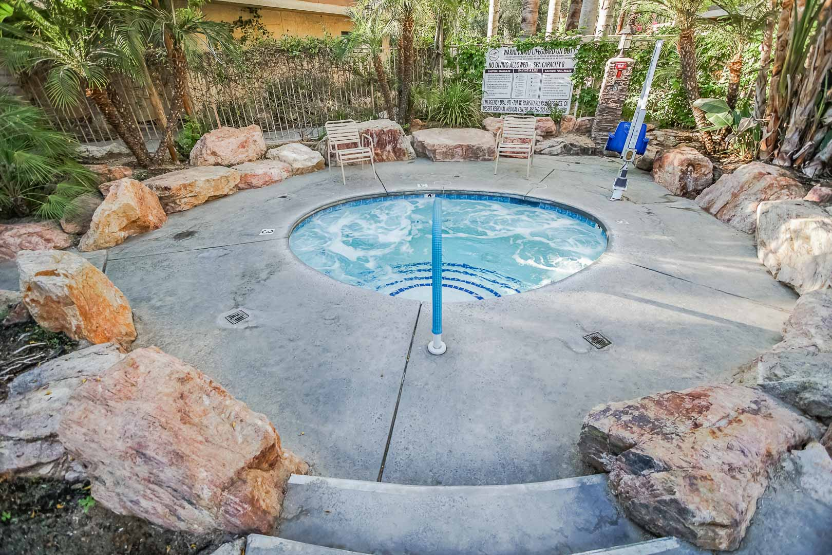 A peaceful outdoor Jacuzzi at VRI's Palm Springs Tennis Club in California.