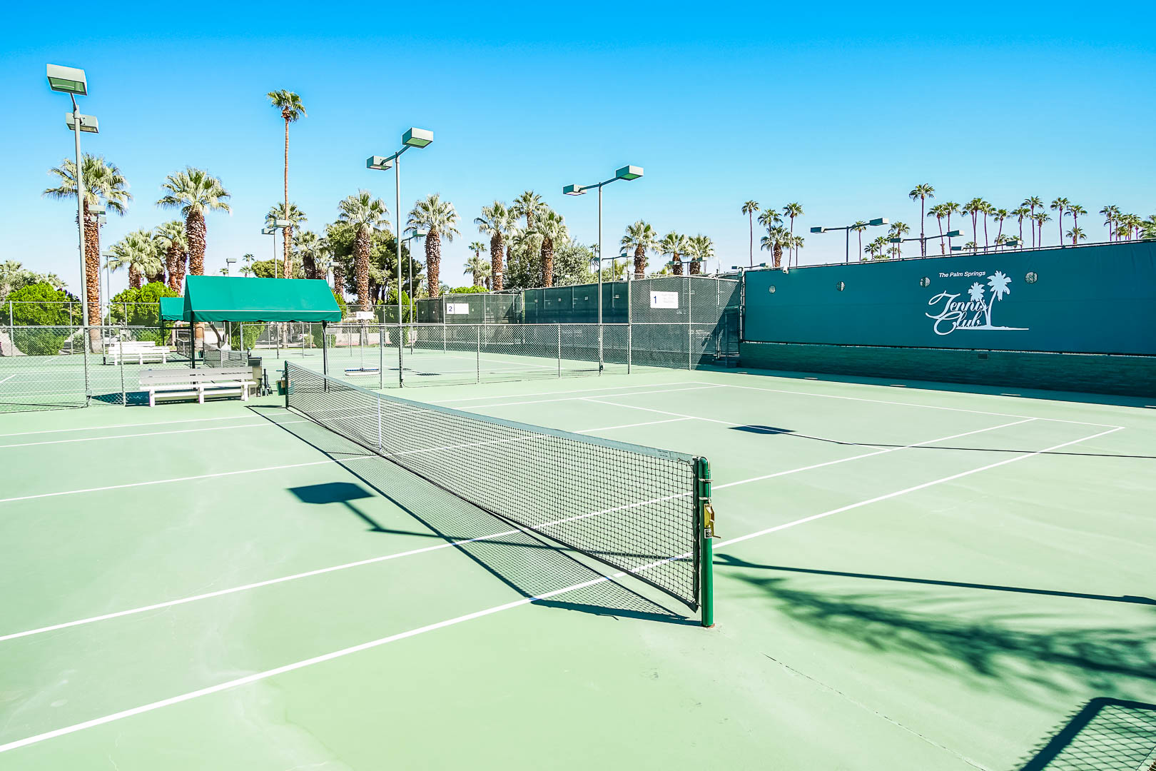 An expansive view of the outdoor tennis courts at VRI's Palm Springs Tennis Club in California.