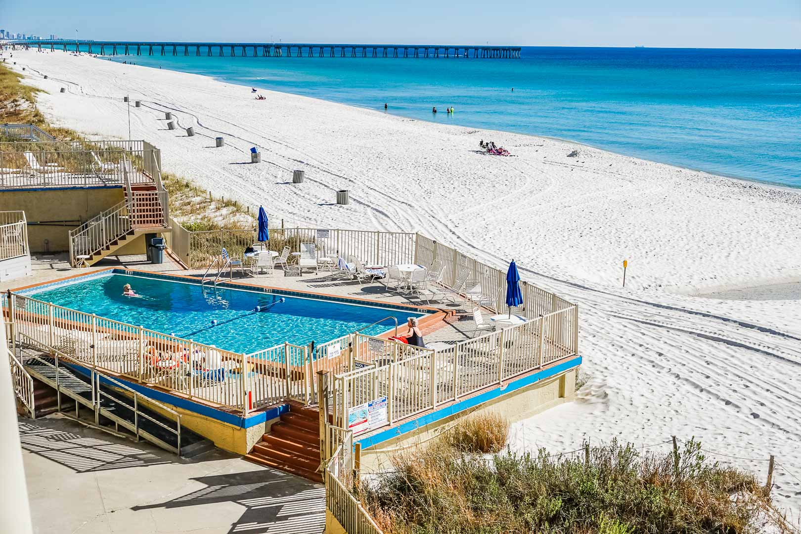 A refreshing pool with beach access at VRI's Panama City Resort & Club in Florida.
