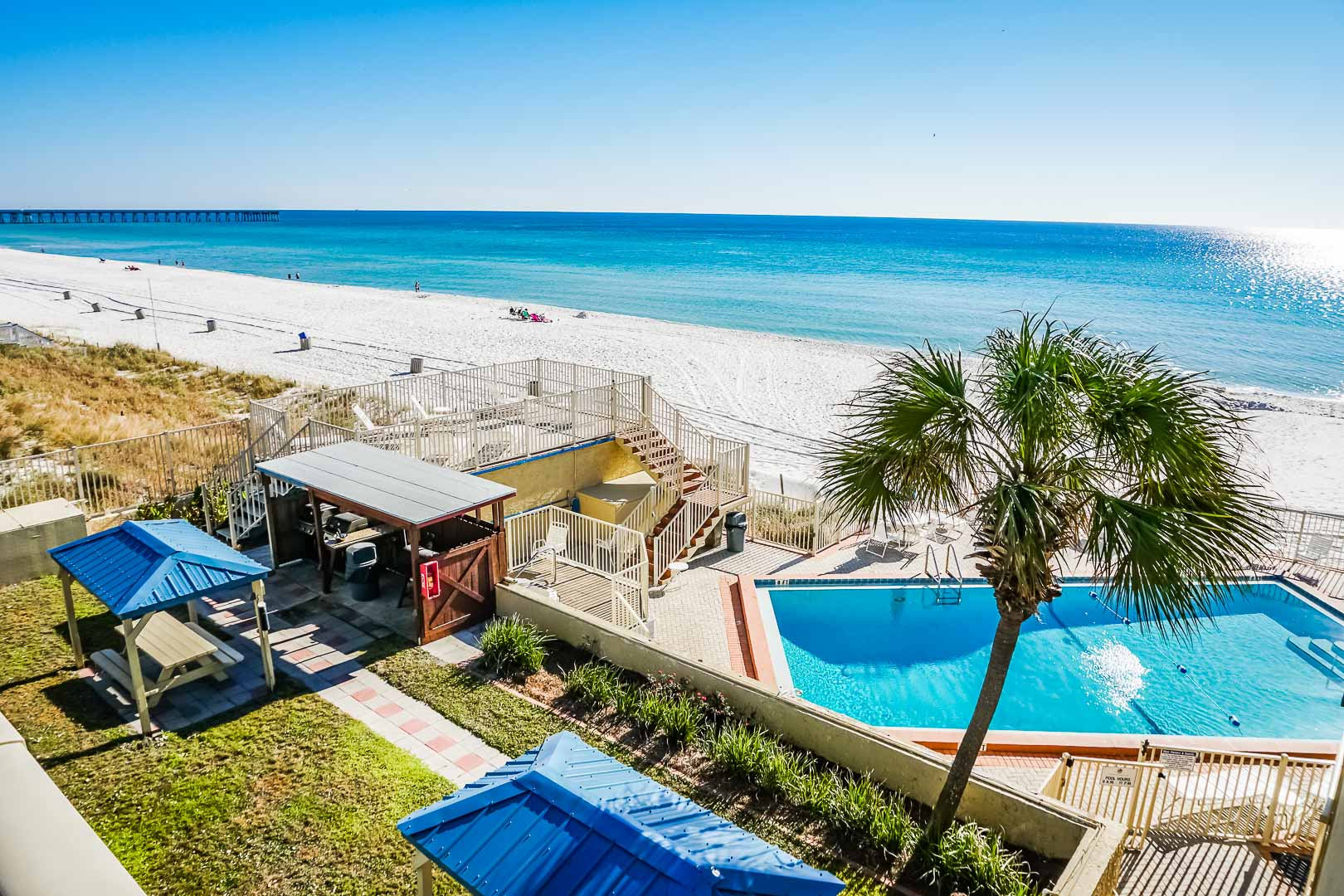 A crisp pool with beach access at VRI's Panama City Resort & Club in Florida.