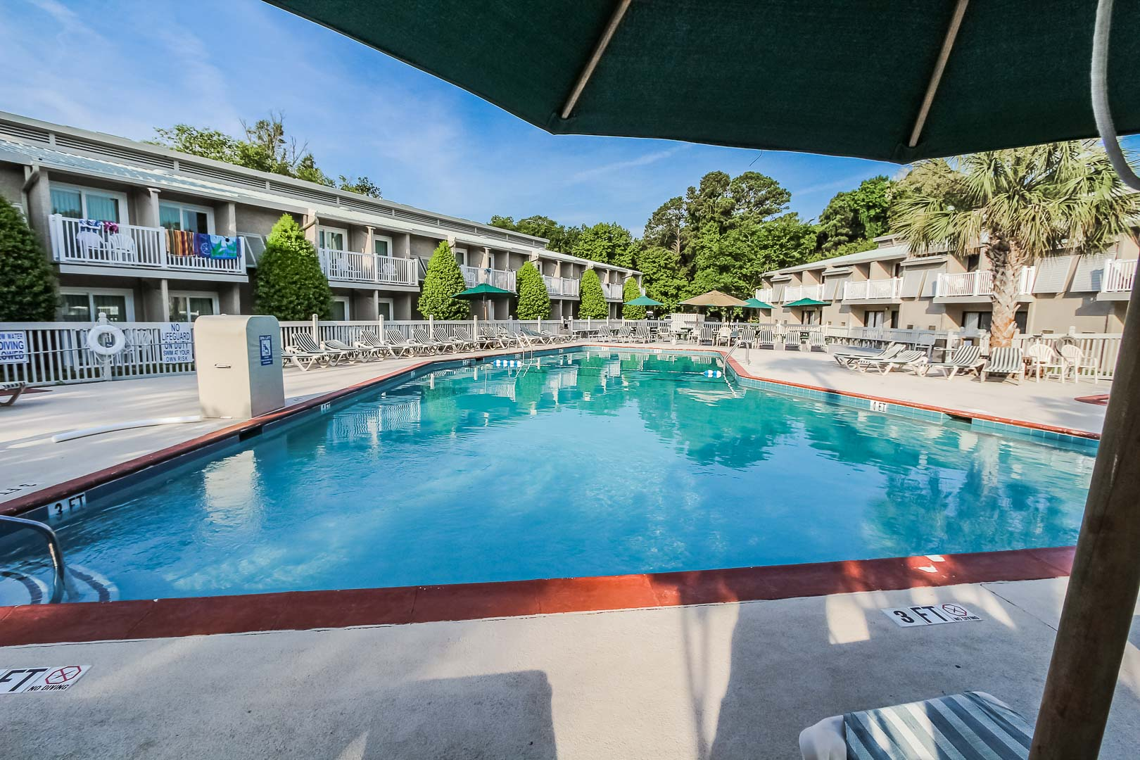 An expansive outdoor swimming pool at VRI's Players Club Resort in Hilton Head Island, South Carolina.
