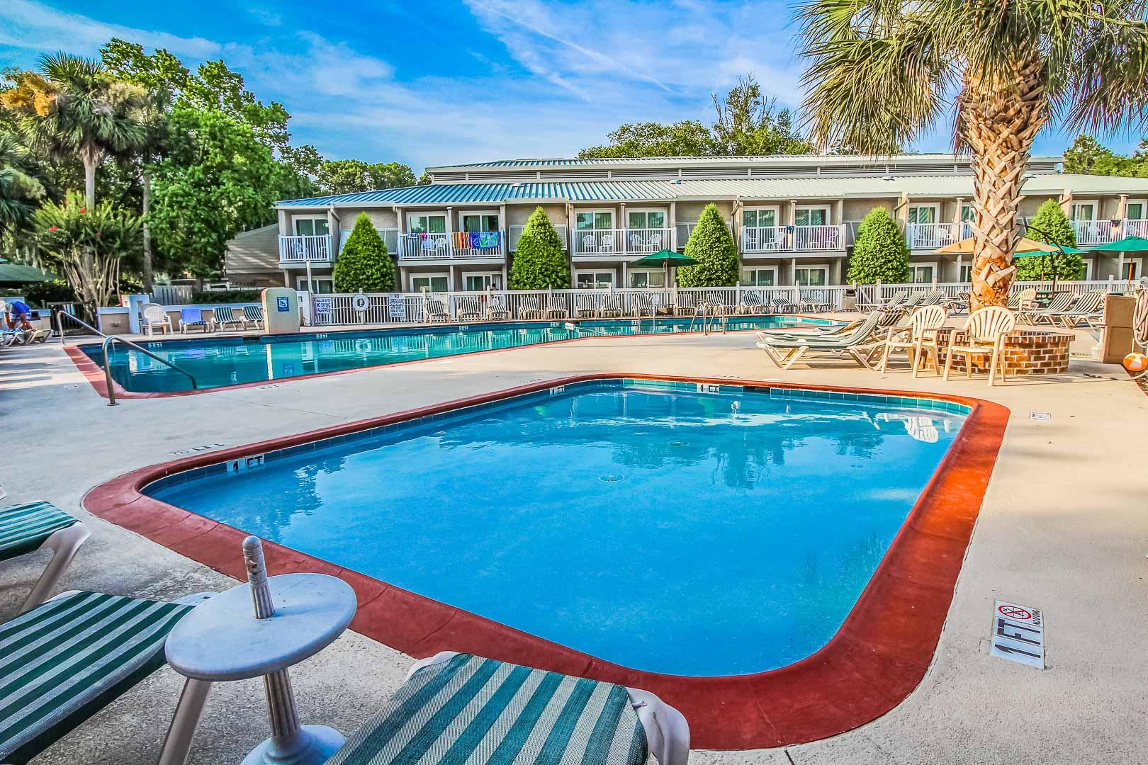 A peaceful outdoor swimming pool at VRI's Players Club Resort in Hilton Head Island, South Carolina.