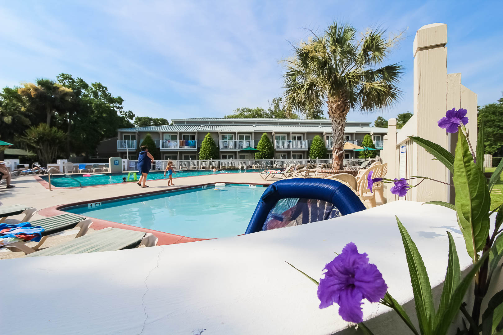 A peaceful view of the outdoor swimming pool at VRI's Players Club Resort in Hilton Head Island, South Carolina.