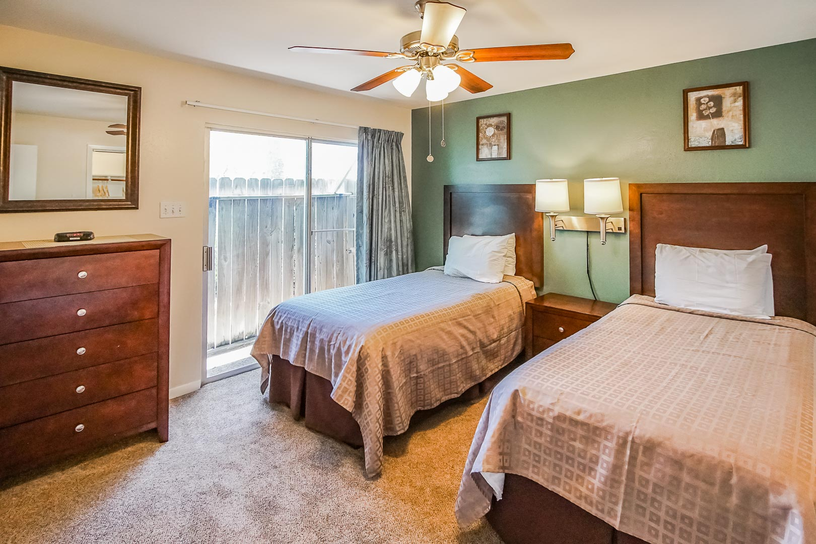 A two bedroom with double beds at VRI's Puente Vista in Texas.