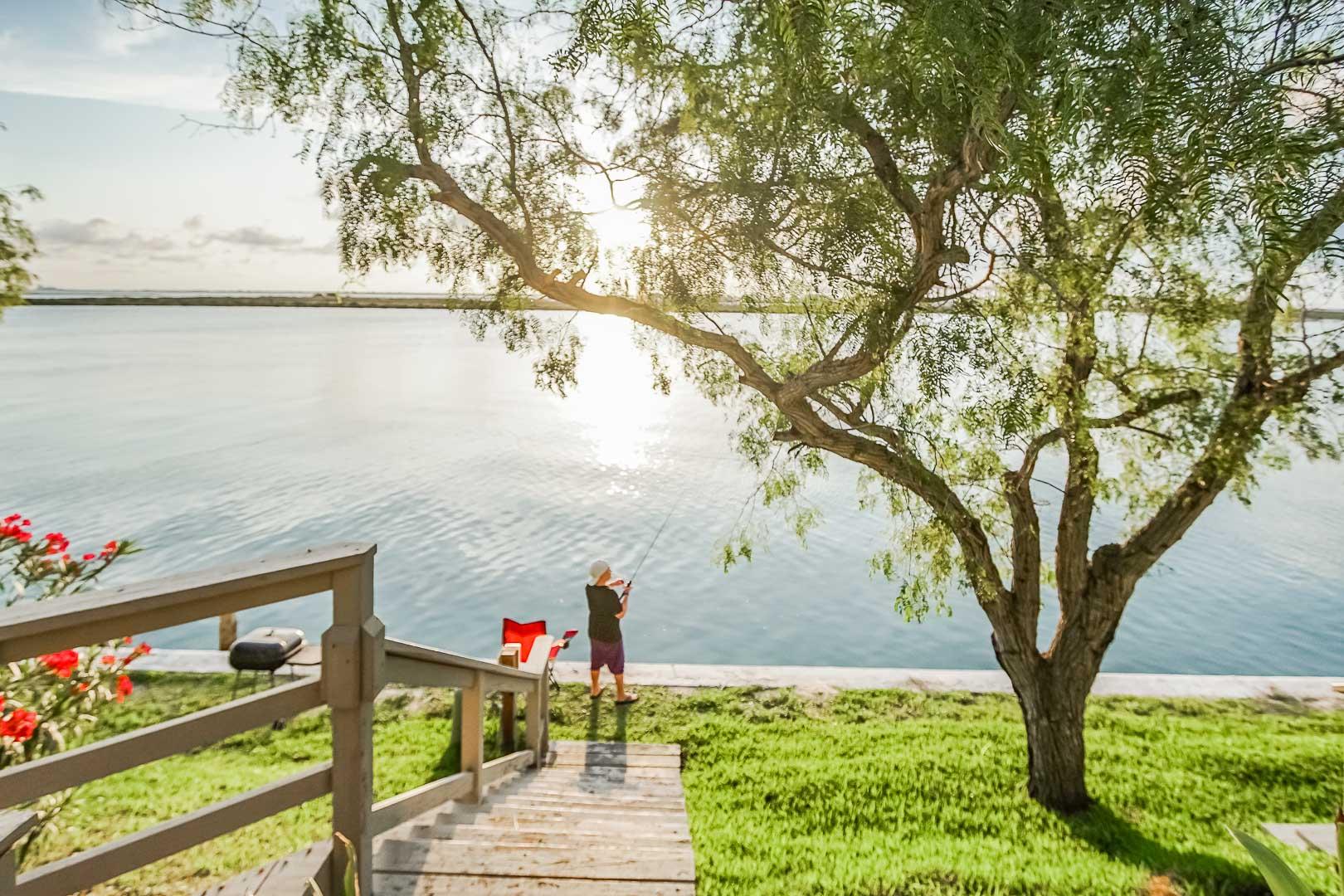 A peaceful lakeside view at VRI's Puente Vista Resort in Texas.