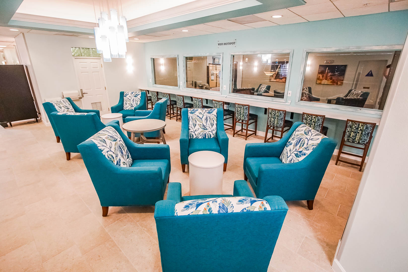 A modern resort lobby area with lounge at VRI's The Resort on Cocoa Beach in Florida.