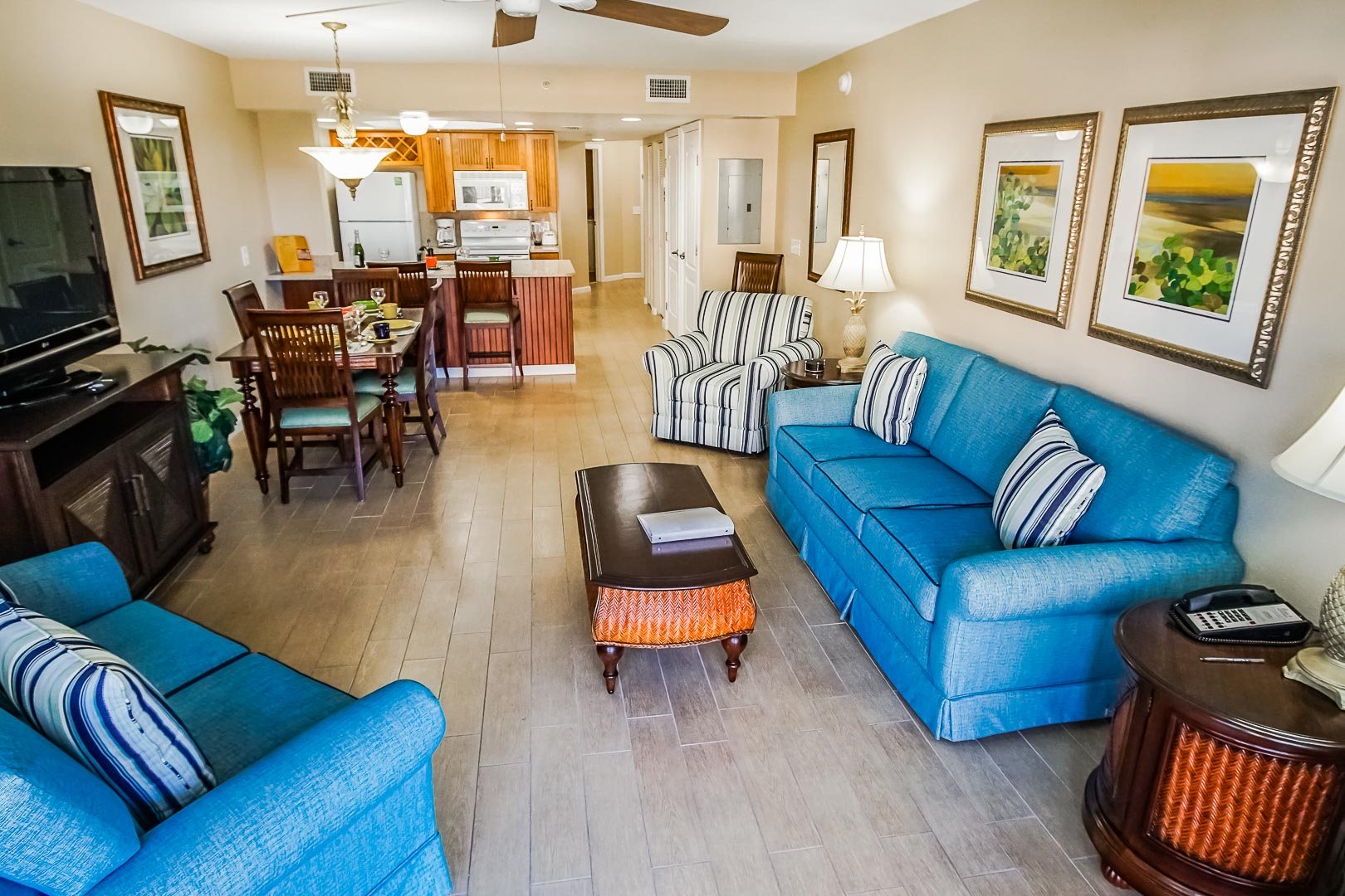 A spacious living room and dining area at VRI's The Resort on Cocoa Beach in Florida.
