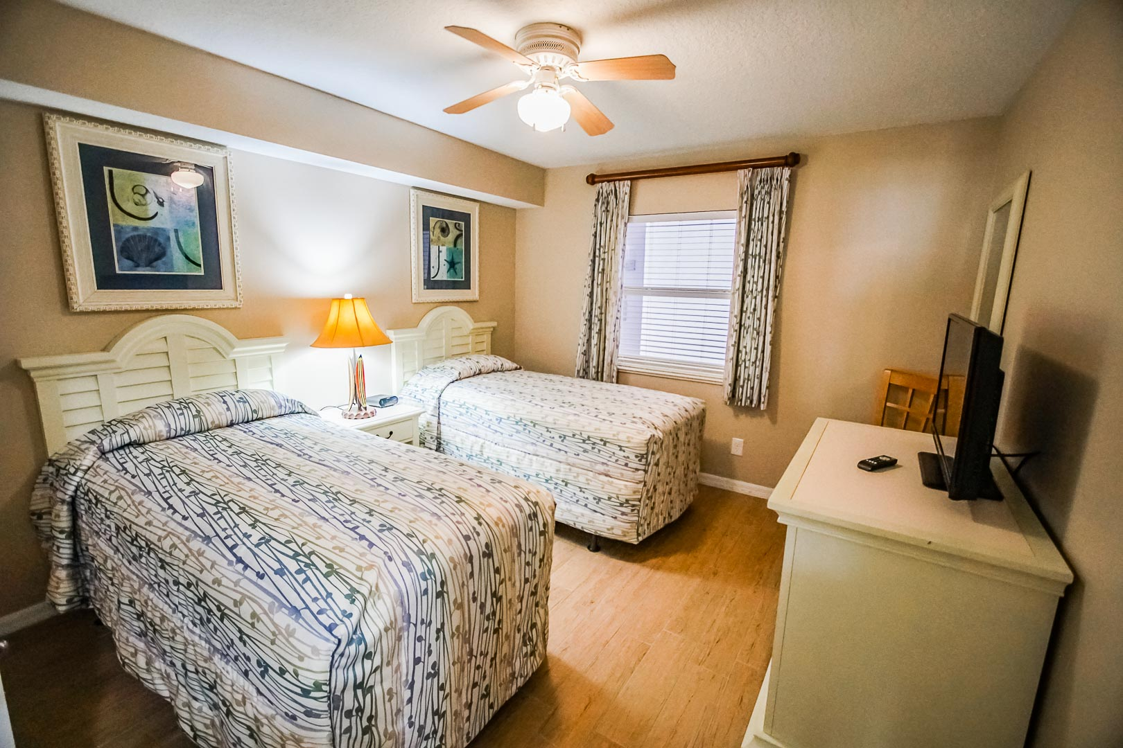 A spacious 2 bedroom unit with twin beds at VRI's The Resort on Cocoa Beach in Florida.