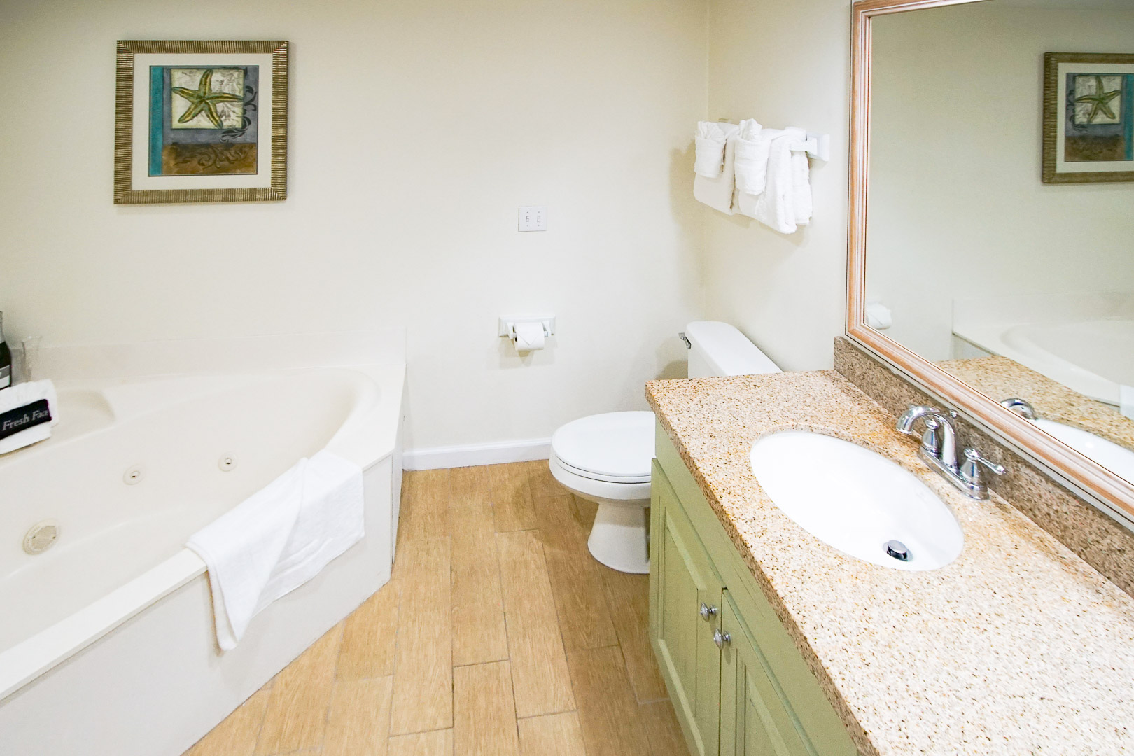 An airy bathroom with jacuzzi tub at VRI's The Resort on Cocoa Beach in Florida.