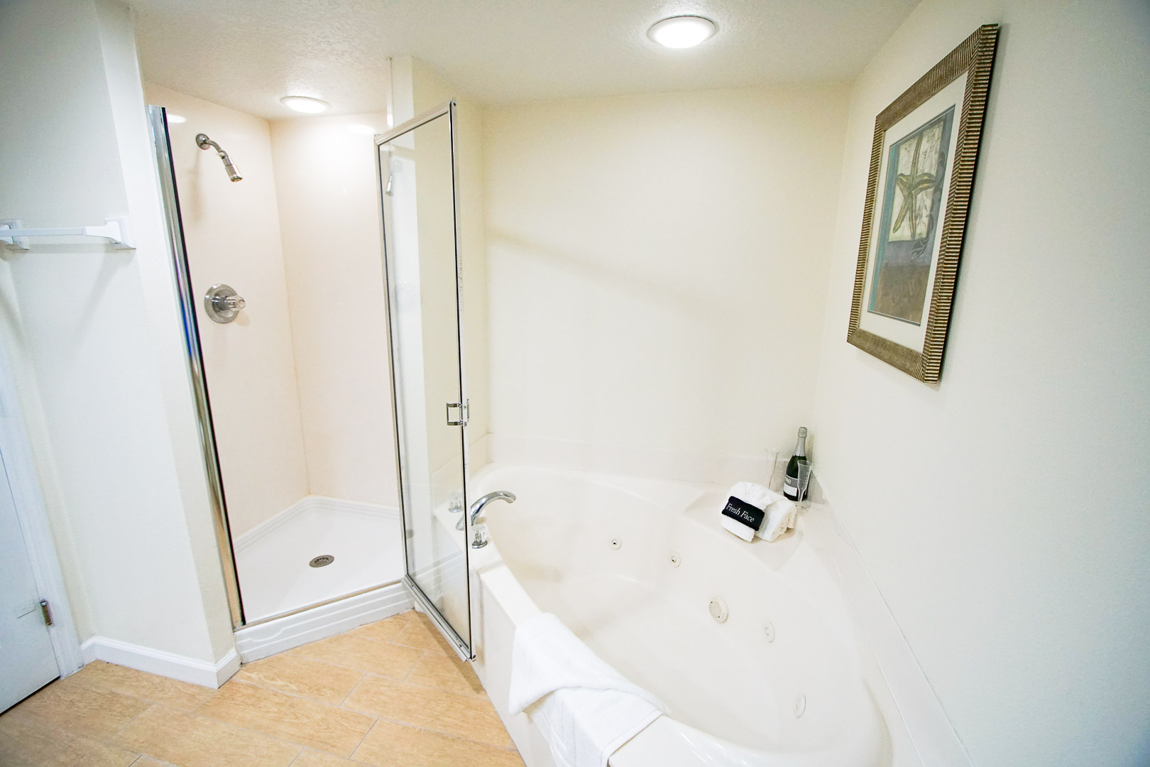 A refreshing bathroom with shower and jacuzzi tub at VRI's The Resort on Cocoa Beach in Florida.