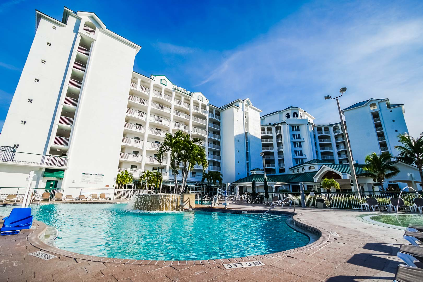 A stoic resort view with a pool at VRI's The Resort on Cocoa Beach in Florida.