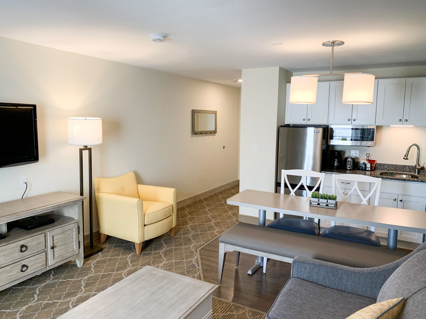 A cozy studio unit with a kitchenette at VRI's Riverview Resort in Massachusetts.
