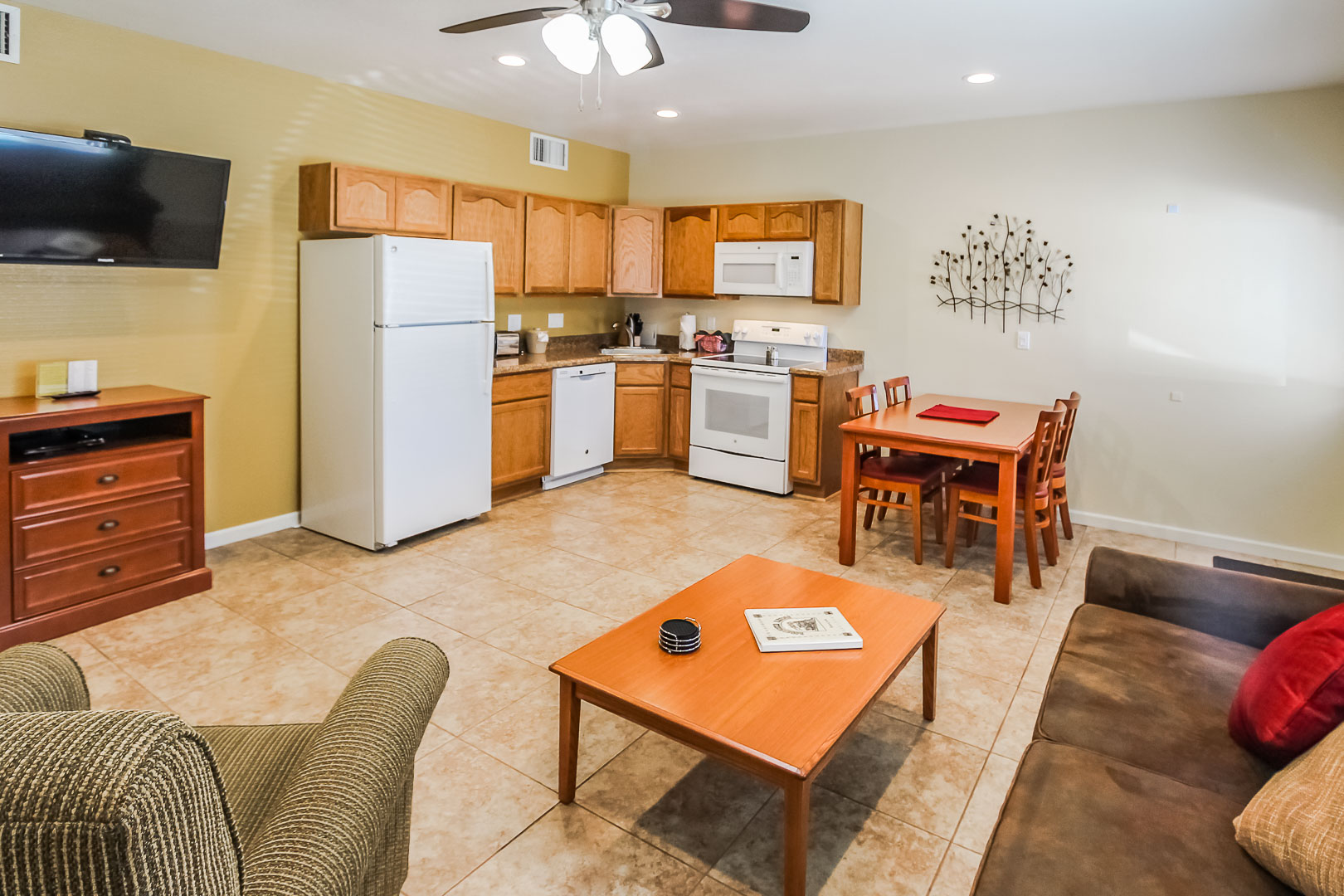 A full size kitchen and living room at VRI's Roundhouse Resort in Pinetop, Arizona.