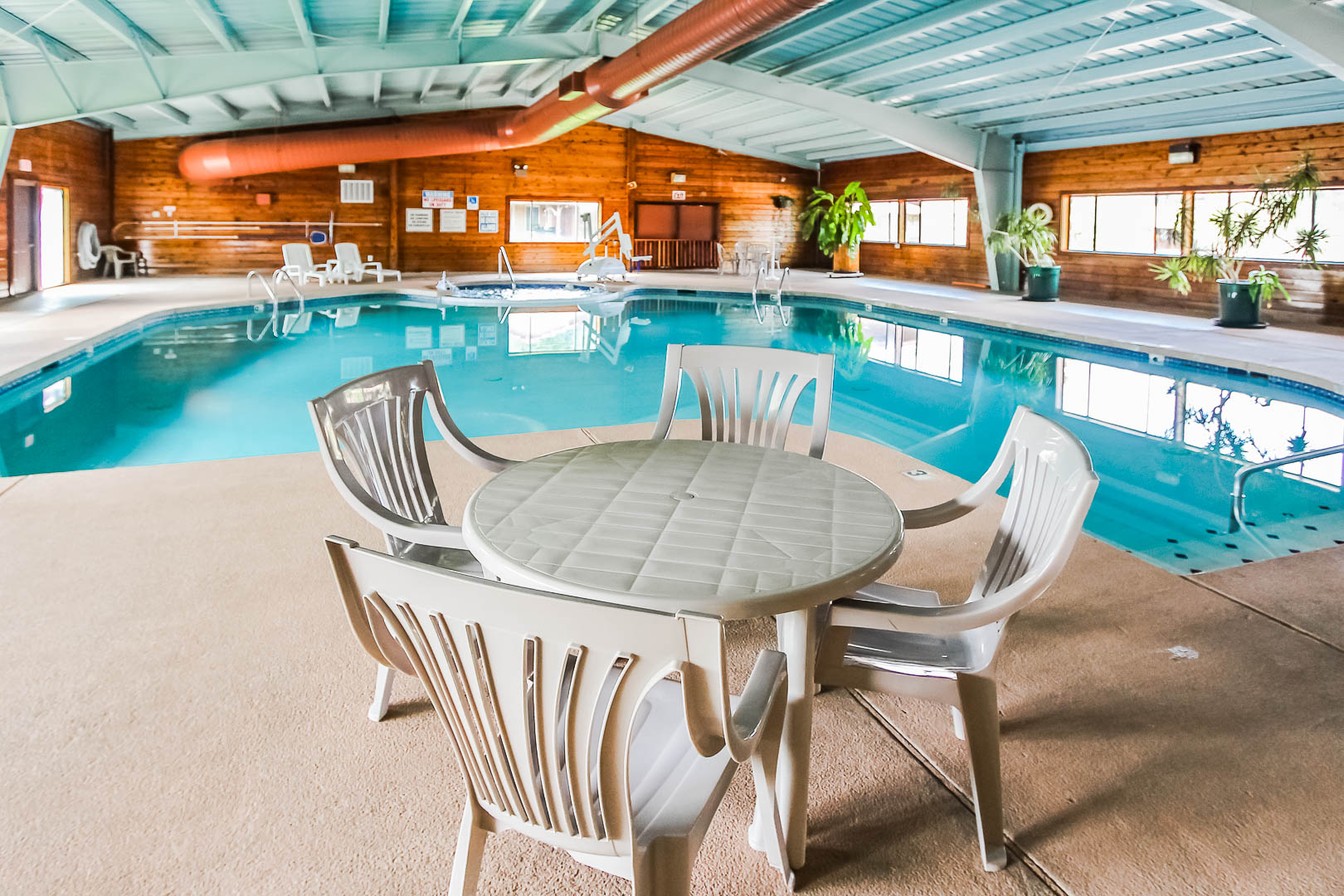A spacious indoor swimming pool at VRI's Roundhouse Resort in Pinetop, Arizona.