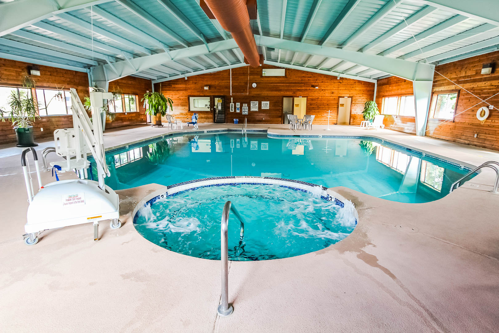 A spacious indoor swimming pool and Jacuzzi at VRI's Roundhouse Resort in Pinetop, Arizona.