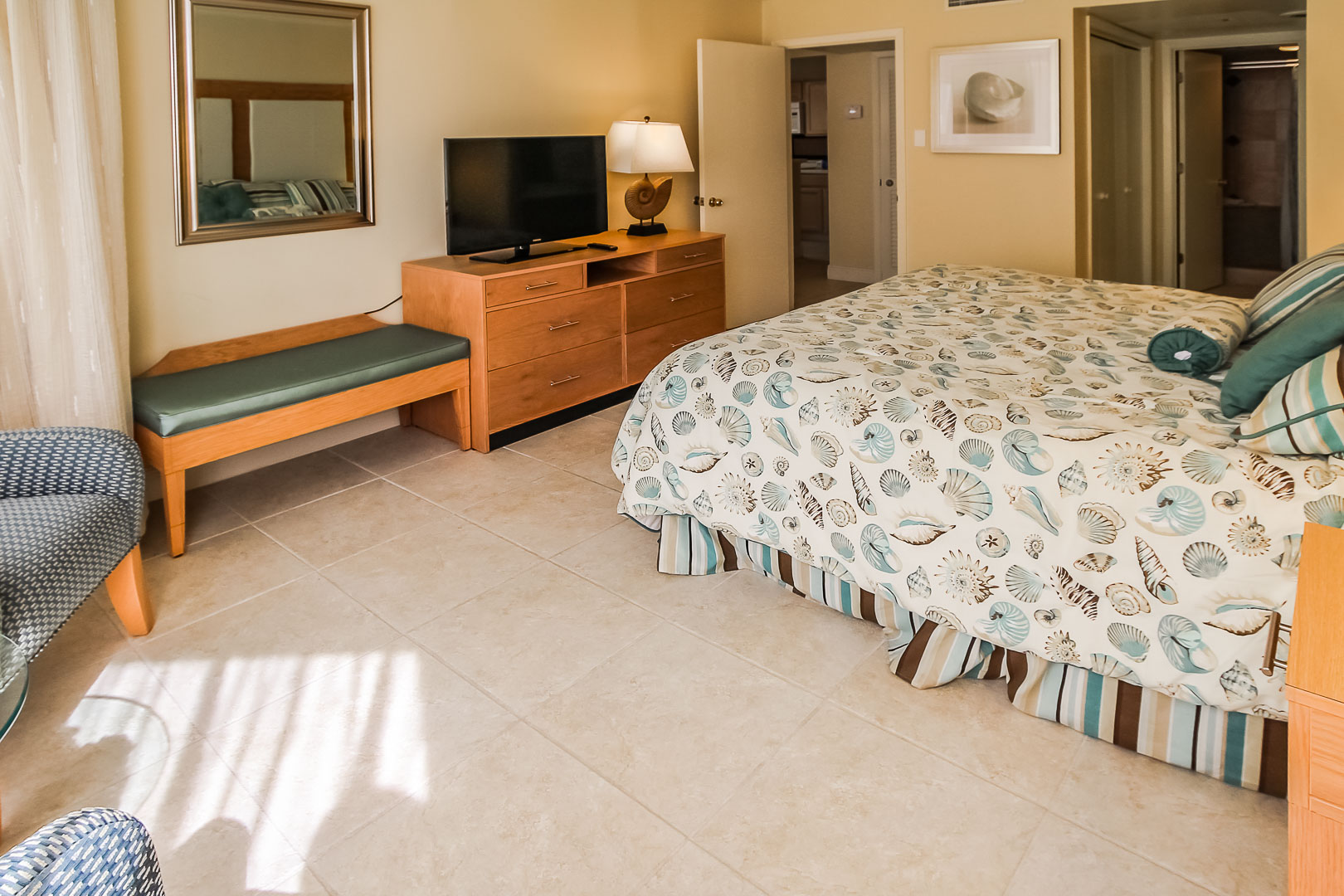 A charming master bedroom at VRI's Royale Beach Tennis Club in Texas.