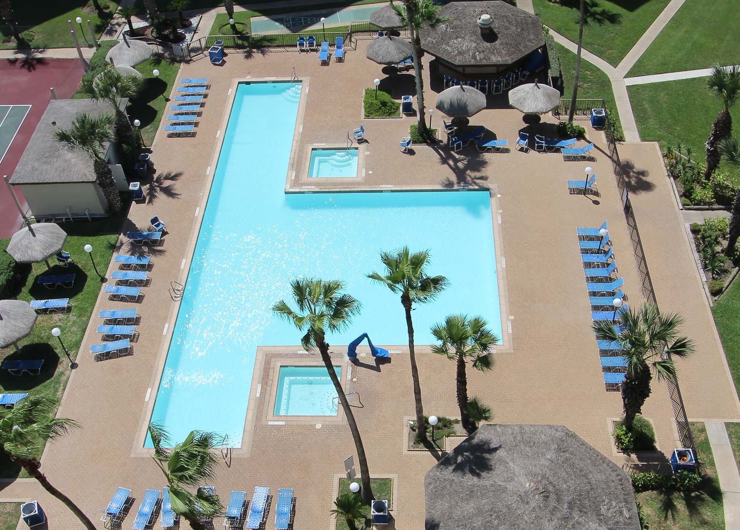 An outdoor swimming pool at VRI's Royale Beach and Tennis Club.