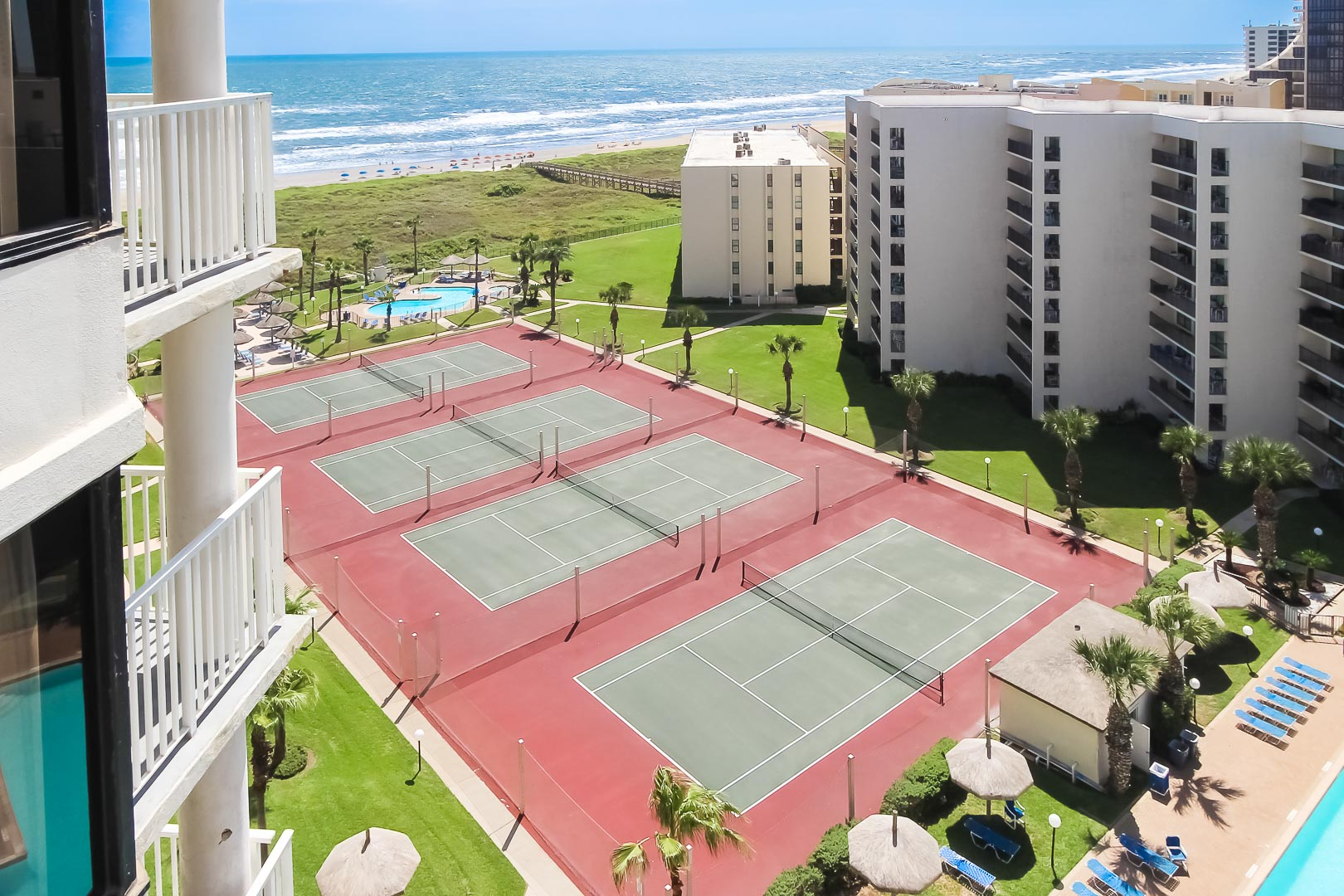 Beachfront Outdoor tennis courts at VRI's Royale Beach and Tennis Club.