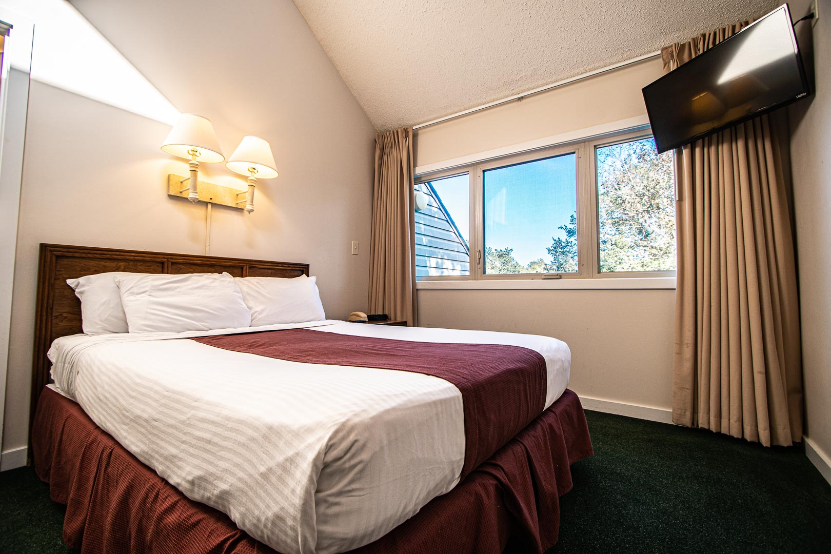 A spacious master bedroom at VRI's Sandcastle Village in New Bern, North Carolina.