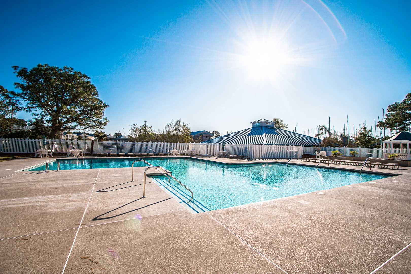 A crisp outdoor swimming pool at VRI's Sandcastle Village in New Bern, North Carolina.