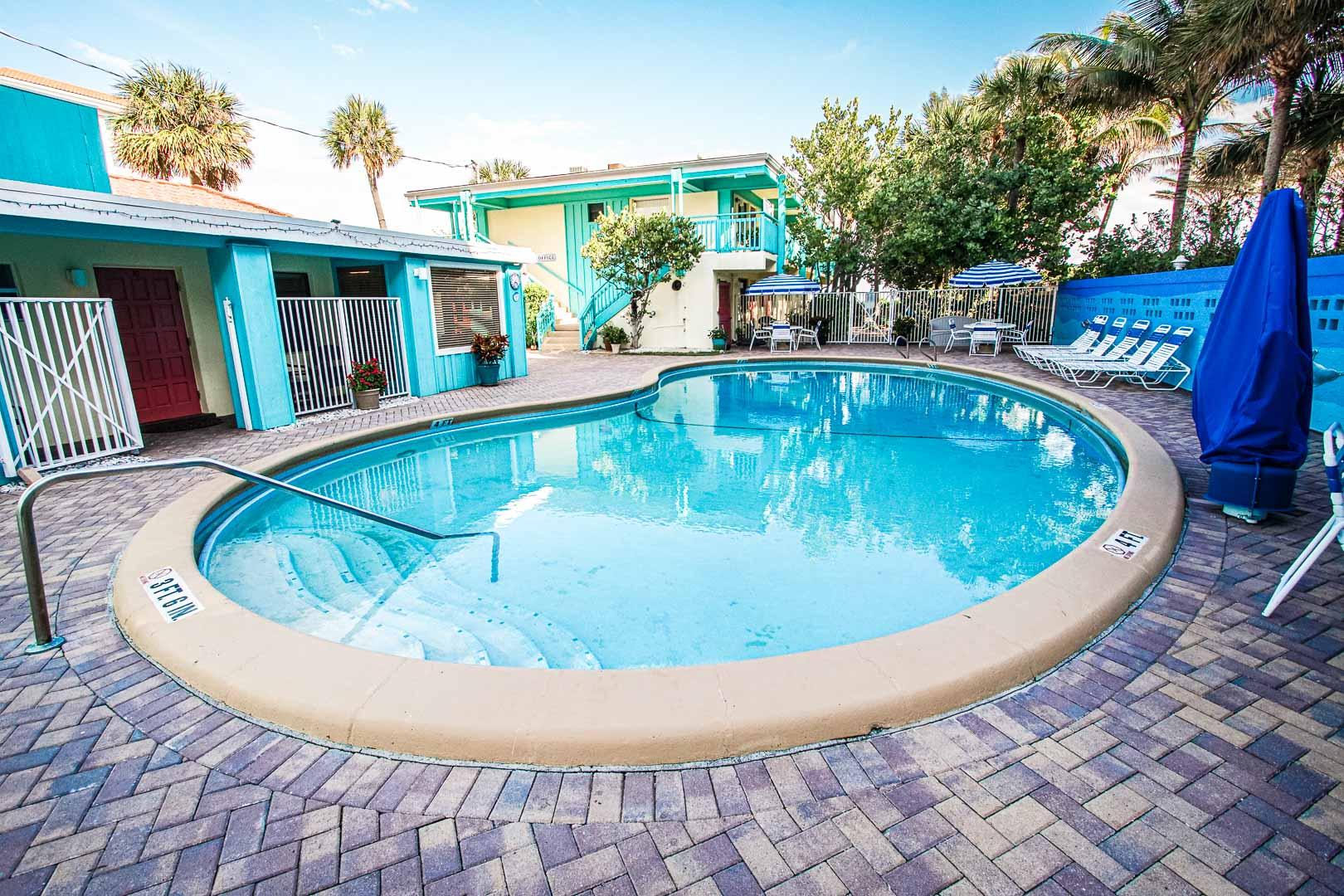 a crisp outdoor swimming pool at VRI's Sand Dune Shores in Florida.