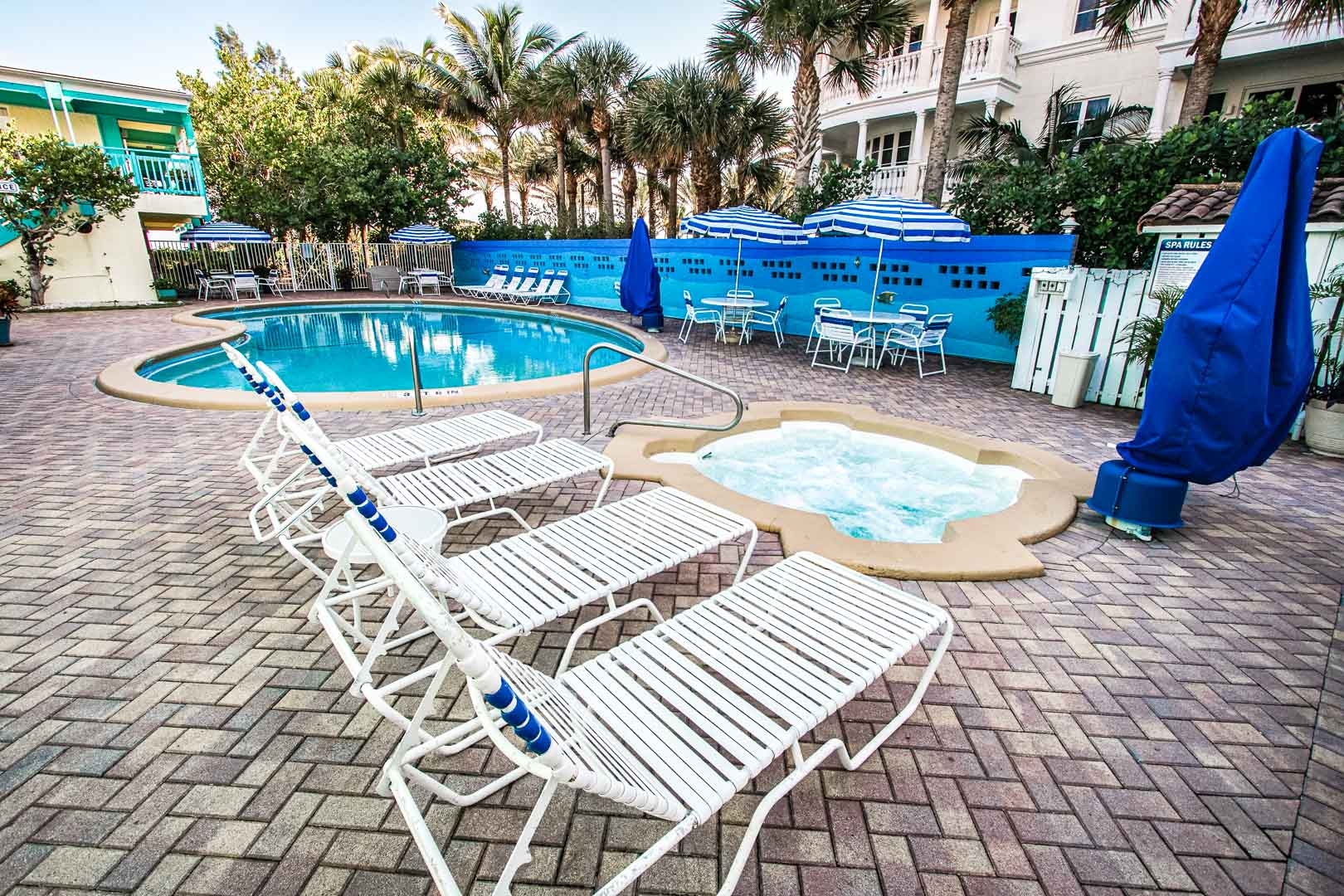 A relaxing outdoor swimming pool at VRI's Sand Dune Shores in Florida.