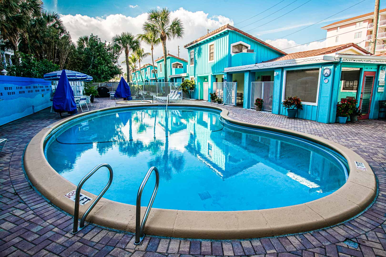 A relaxing swimming pool at VRI's Sand Dune Shores in Florida.