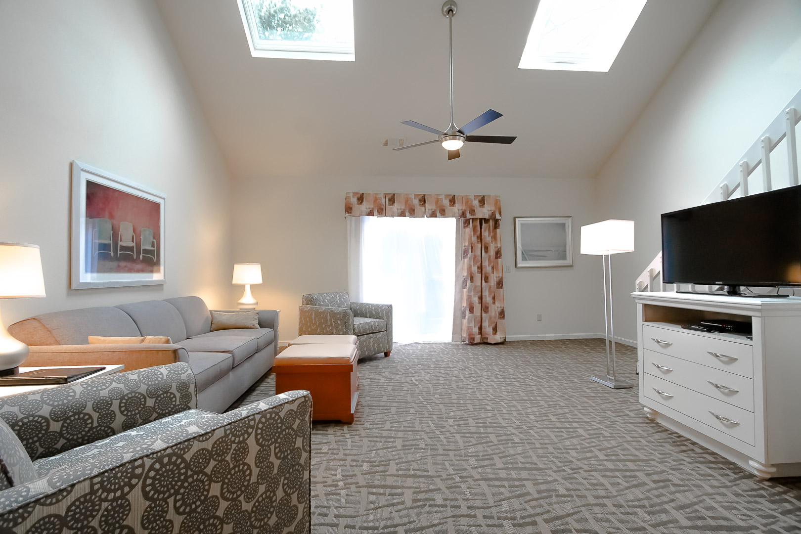 A spacious living room area at VRI's Sea Mist Resort in Massachusetts.