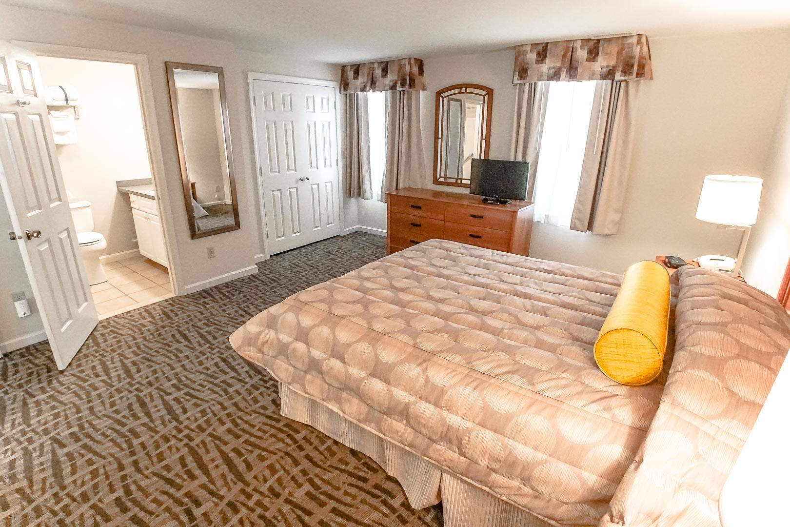 A charming master bedroom at VRI's Sea Mist Resort in Massachusetts.