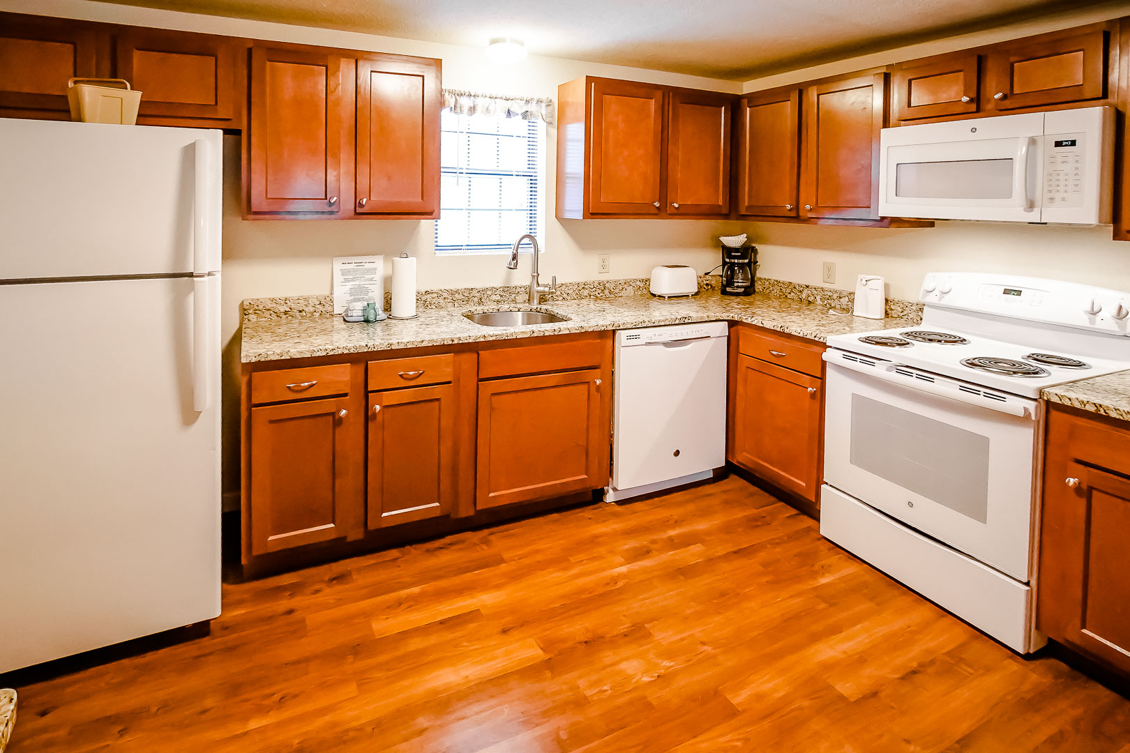 An expansive view of a fully equipped kitchen at VRI's Sea Mist Resort in Massachusetts.
