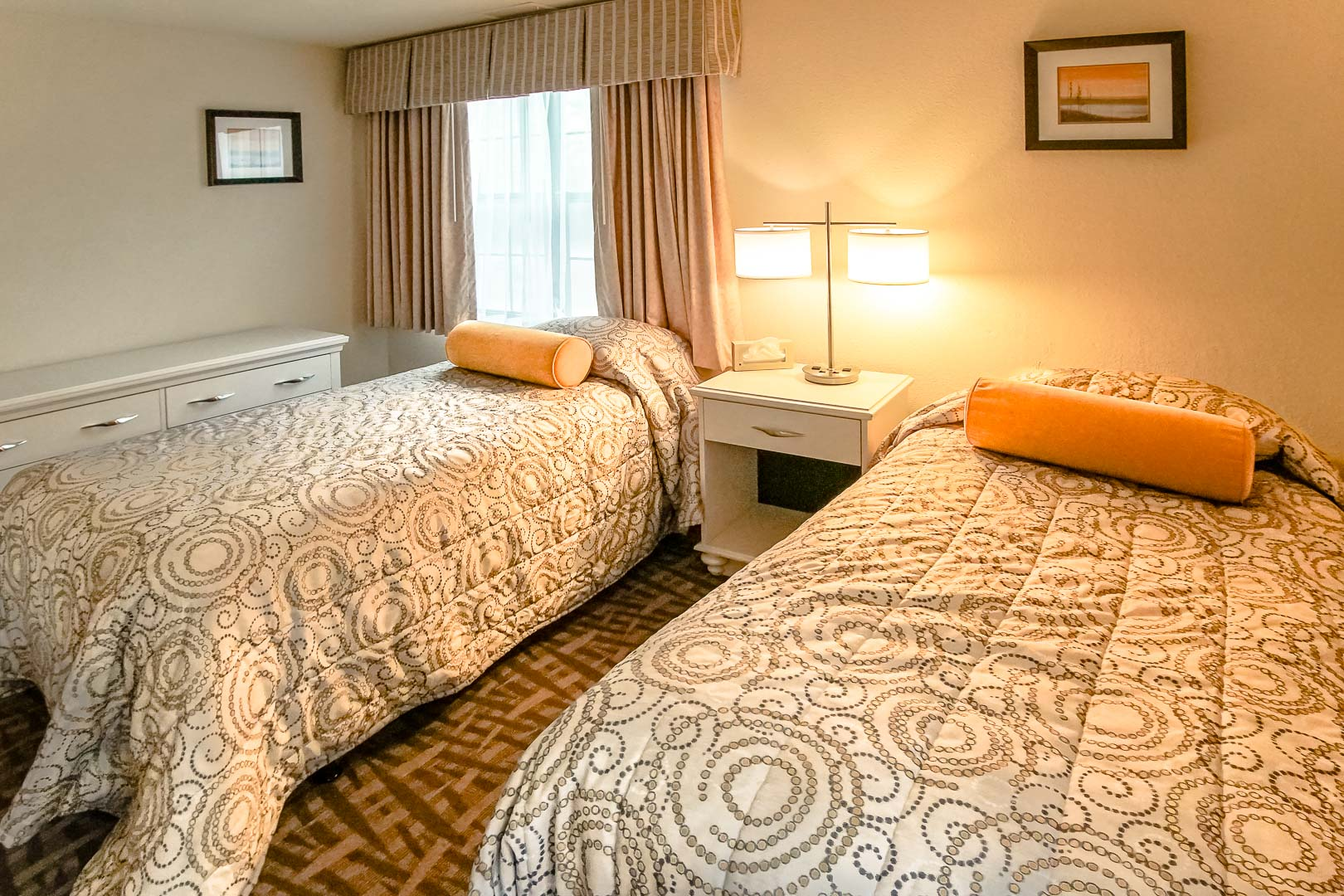 A traditional two bedroom unit with double beds at VRI's Sea Mist Resort in Massachusetts.