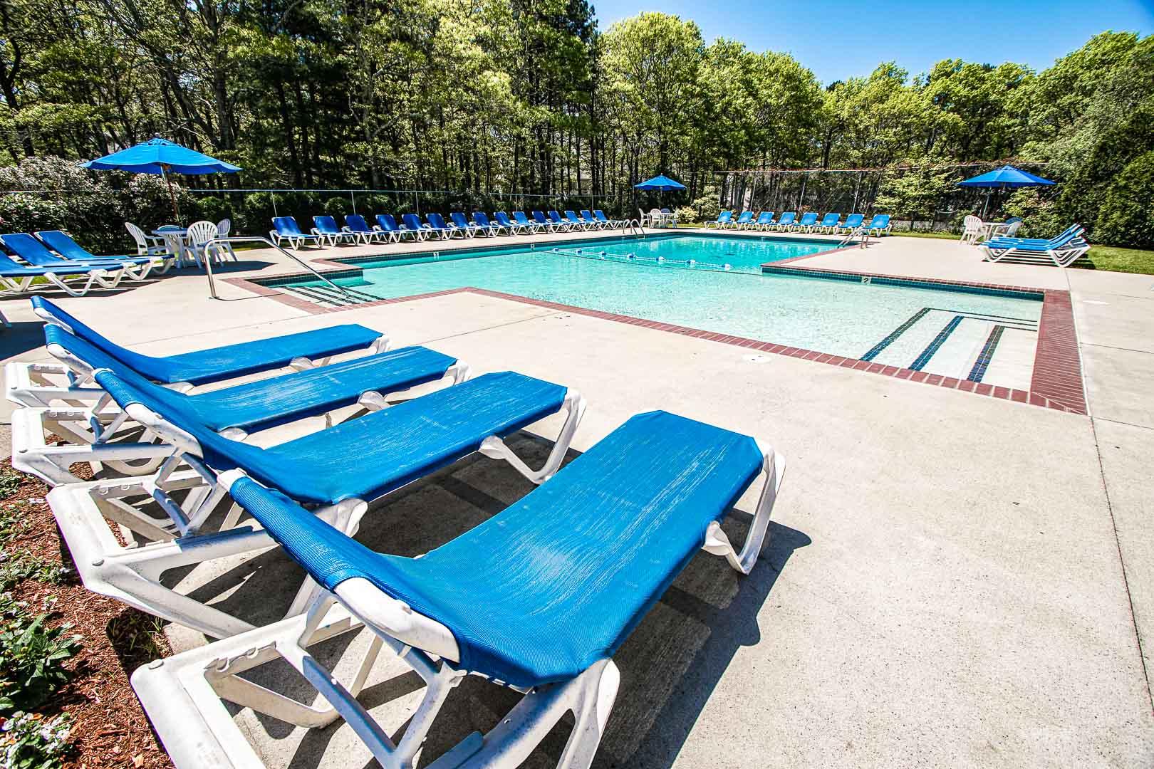 A peaceful outdoor swimming pool at VRI's Sea Mist Resort in Massachusetts.