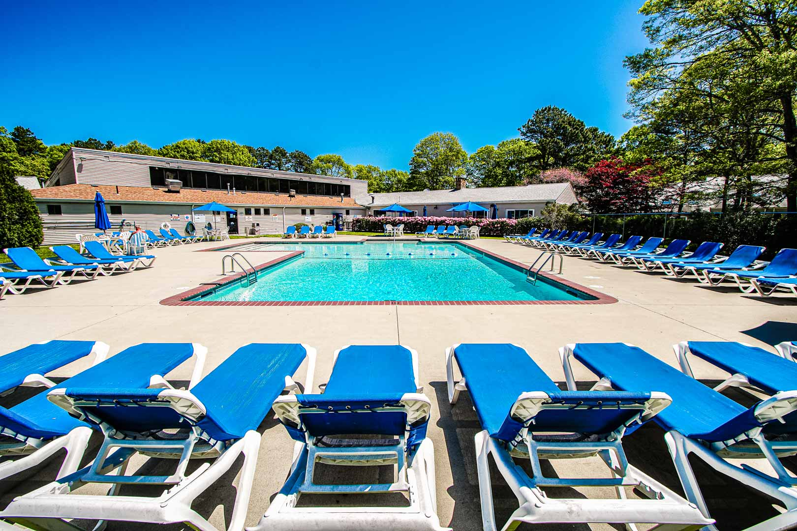 A scenic view of the outside swimming pool at VRI's Sea Mist Resort in Massachusetts.