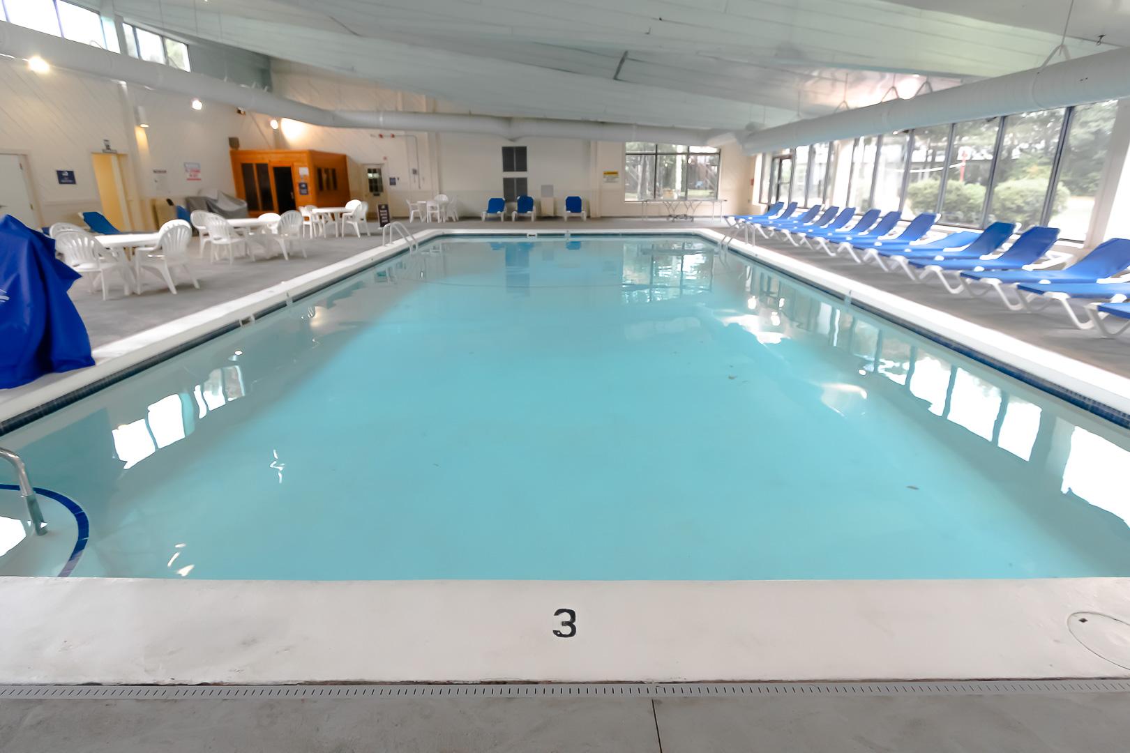 A cozy indoor swimming pool at VRI's Sea Mist Resort in Massachusetts.