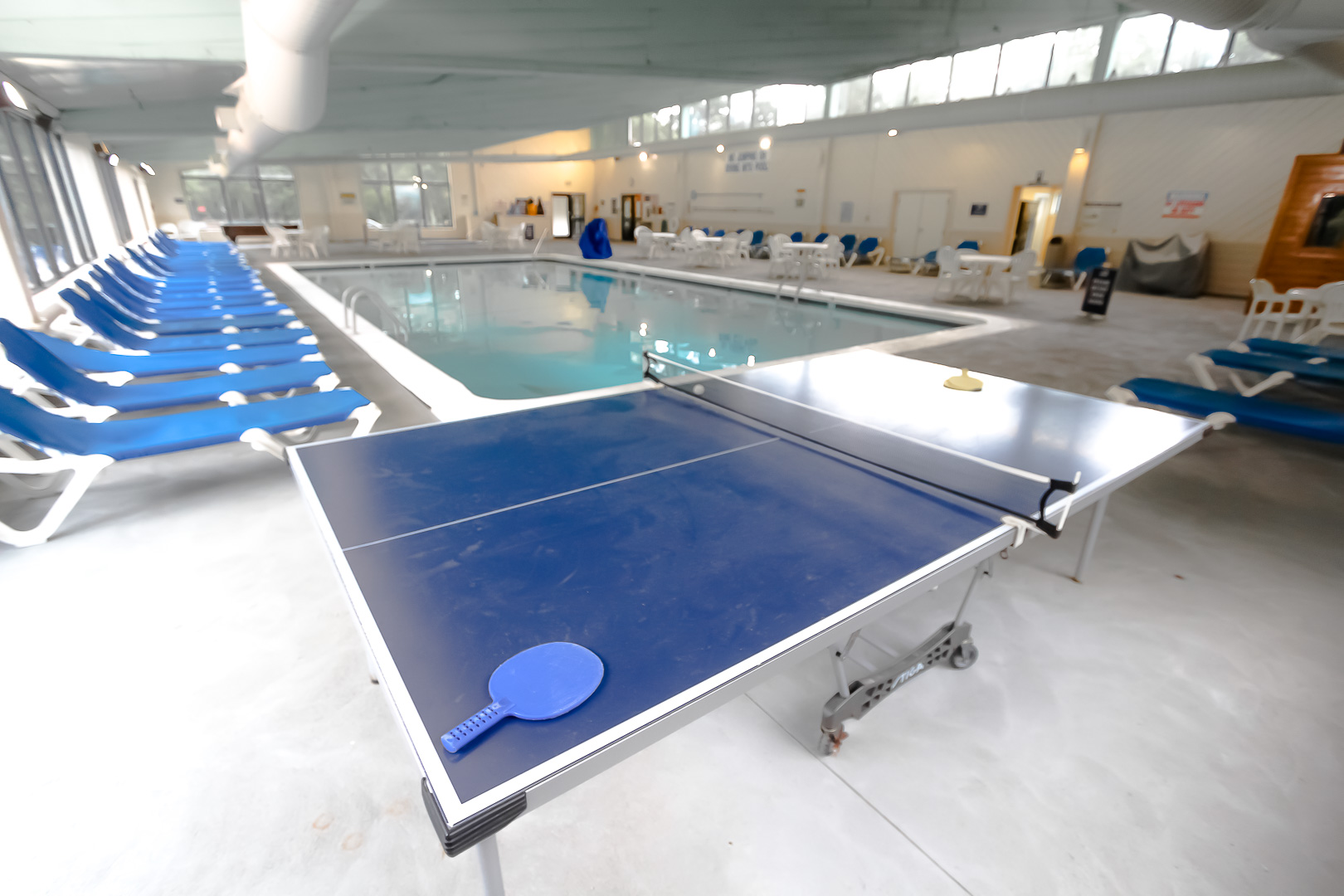 An indoor swimming pool with ping pong table VRI's Sea Mist Resort in Massachusetts.
