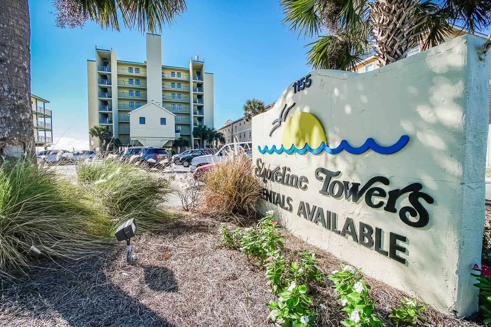 A beautiful resort entrance and signage at VRI's Shoreline Towers in Gulf Shores, Alabama.