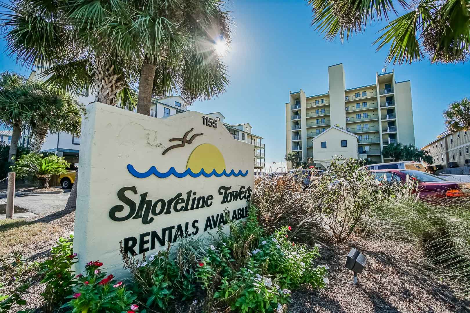 A vibrant resort signage at VRI's Shoreline Towers in Gulf Shores, Alabama.